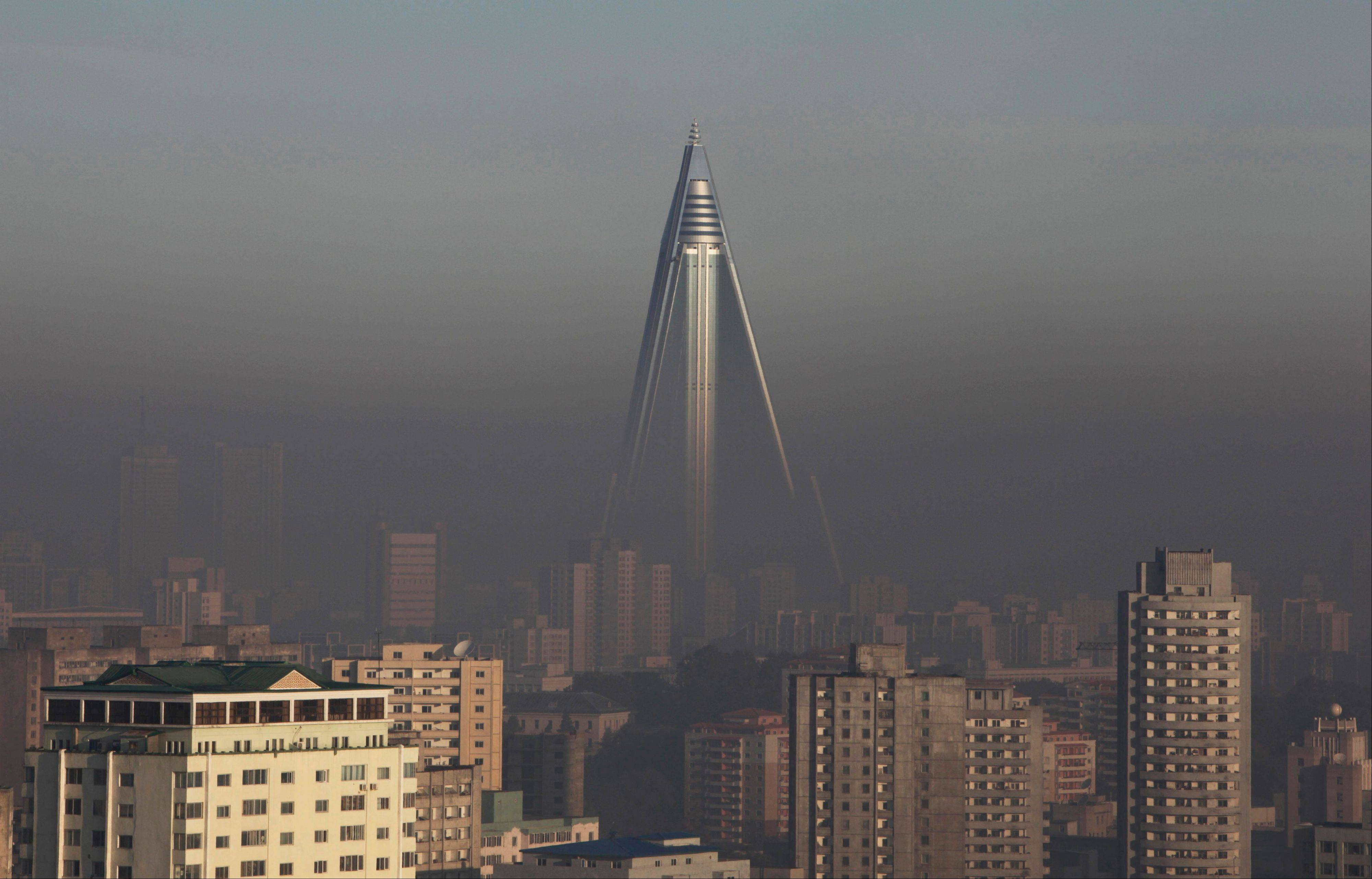In October 2011, the 105-story Ryugyong Hotel stands above others in Pyongyang, North Korea. Throughout the capital, and in cities and towns across the country, construction workers are trying to finish building renovations and major projects as the country prepares for celebrations on April 15 to mark the 100th anniversary of the birth of North Korea founder Kim Il Sung.