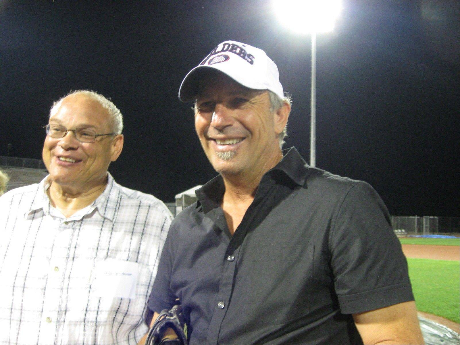 Actor Kevin Costner, billed as a Lake County Fielders co-owner, is with Zion Mayor Lane Harrison in July 2010 when lights were turned on for the first time at the city's temporary ballpark.