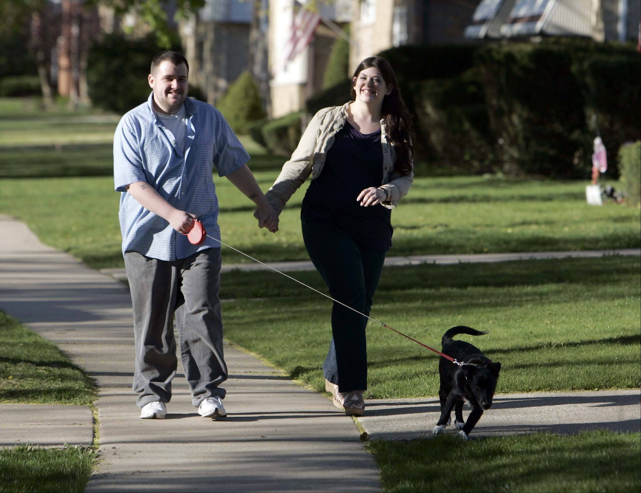 Fittest Loser Michael White and his wife, Lisa, can often be seen walking their dog Staley near their West Dundee home.
