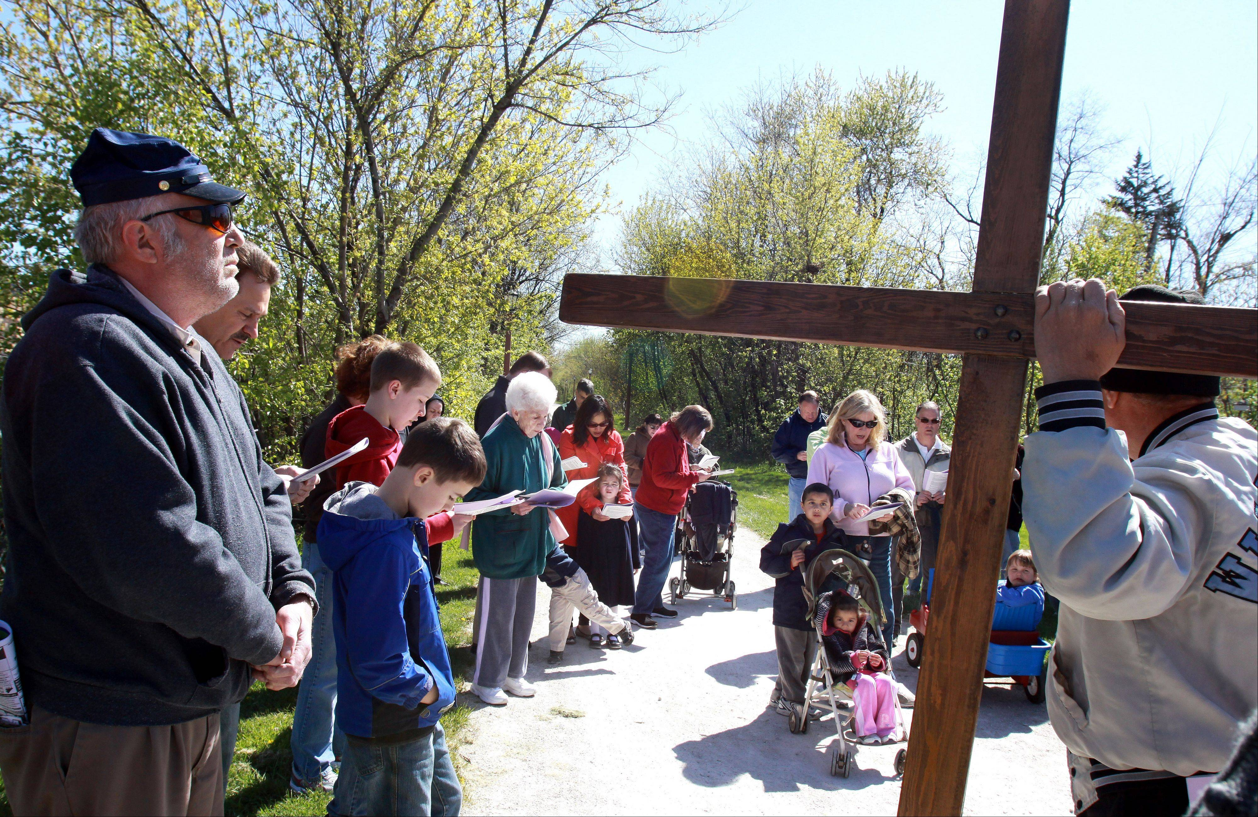 Parishioners take part in the 20th annual St. Alexander Church Good Friday Walk in Villa Park.
