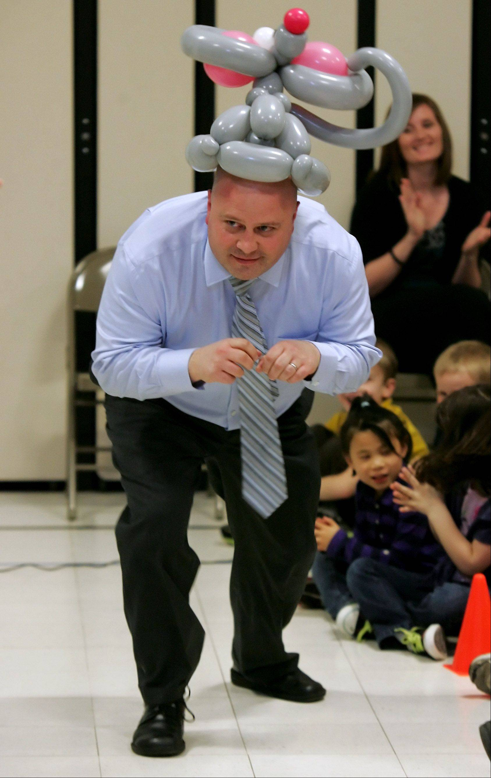 "Adler Park School students laugh as they watch Principal Jon Bogie pretend to be a mouse during the ""Mousetrap Machine Show"" presented by Smarty Pants. Smarty Pants used balloons to illustrate principals of simple machines creating a levers, pulleys, and wheels until a mousetrap was finally created."