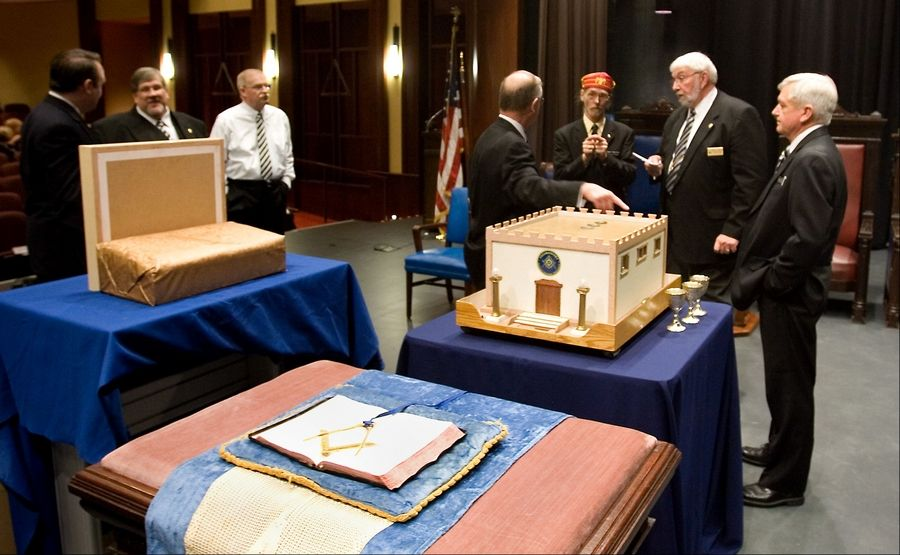 Terry L. Seward, Grand Master of the Grand Lodge of Illinois, second from right, performs a ceremonial dedication March 17 at the Scottish Rite Valley of Chicago's new facility in Bloomingdale. The ceremony involved pouring corn, oil and wine over a model of King Solomon's temple, after which all Masonic facilities are modeled.