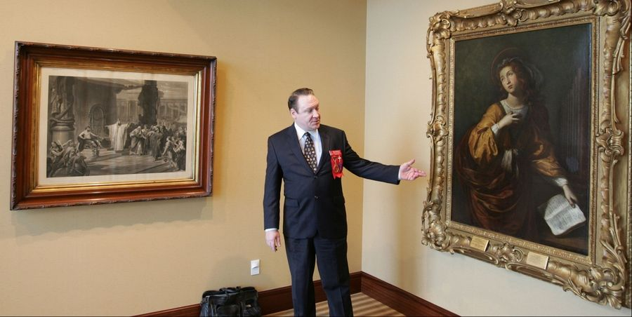 Paul Scheeler points out artwork inside the Scottish Rite Valley of Chicago's new facility in Bloomingdale. The building has an art museum and library as well as a Masonic Lodge room, a theater and a banquet hall. At left is representation artwork of King Solomon's temple, after which all Masonic facilities are modeled.