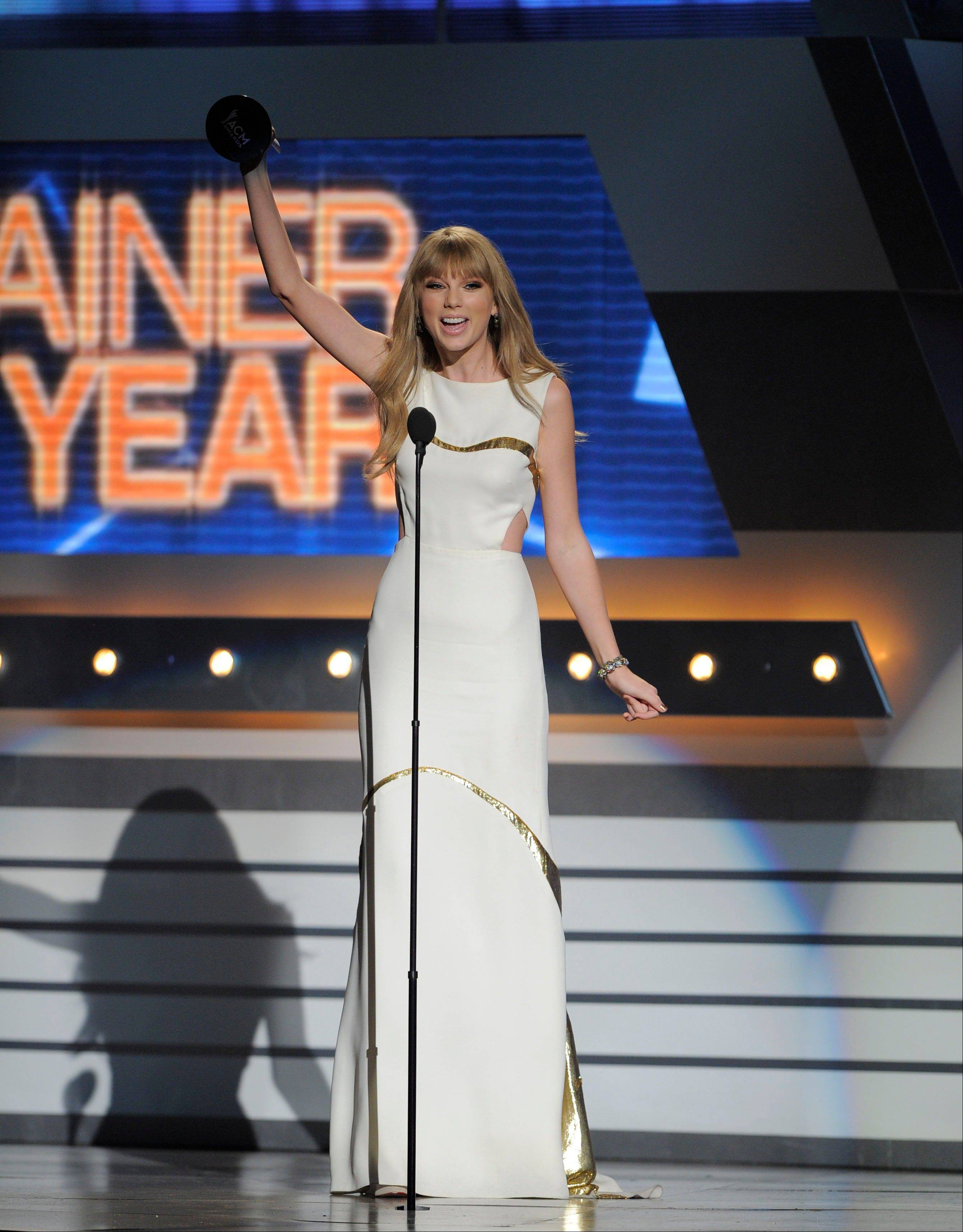 Taylor Swift accepts the award for entertainer of the year at the 47th Annual Academy of Country Music Awards on Sunday in Las Vegas.