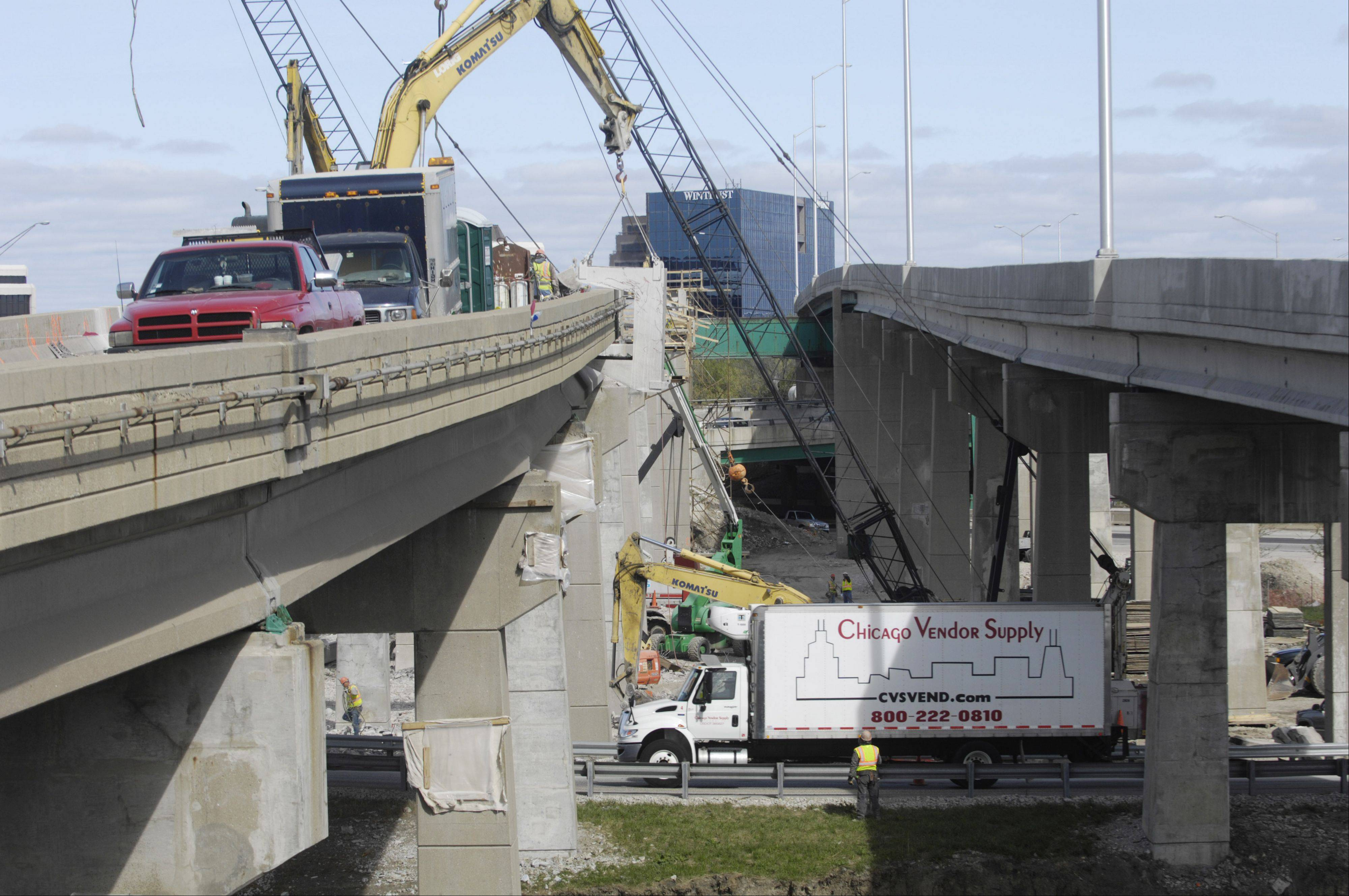 The deck of the existing tri-level bridge connecting northbound I-294 to westbound I-90, left, is being removed during reconstruction of the roadway.