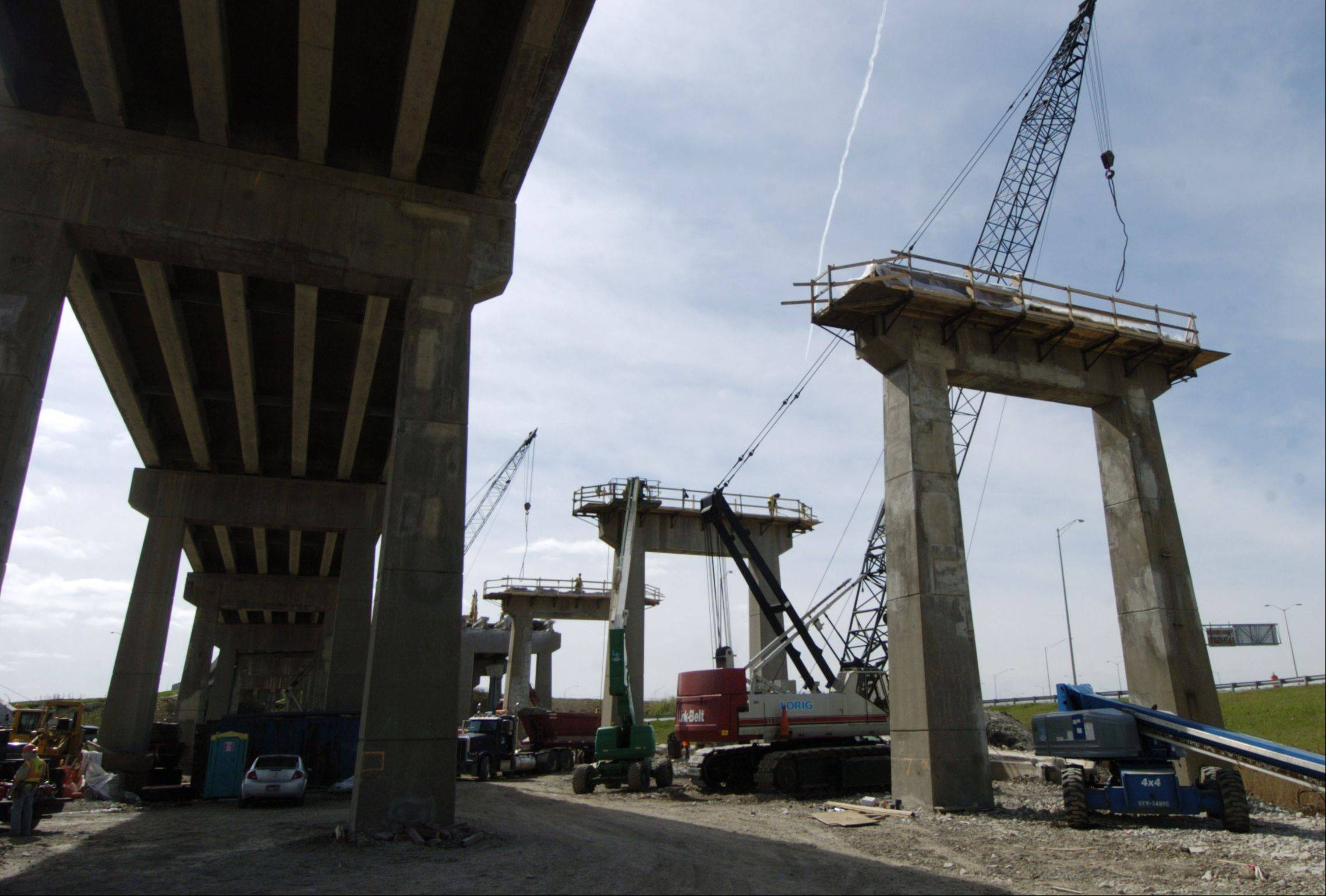 The deck of the existing tri-level bridge connecting northbound I-294 to westbound I-90, right, is being removed during reconstruction of the roadway.