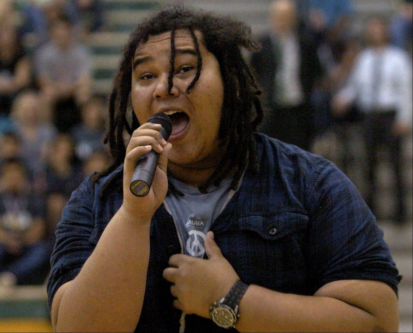 "Nick Gaines, who took second place in the District U46 talent show, sings ""Not Over You,"" by Gavin Degraw, at Bartlett High School's Activities and Organization Recognition Assembly."