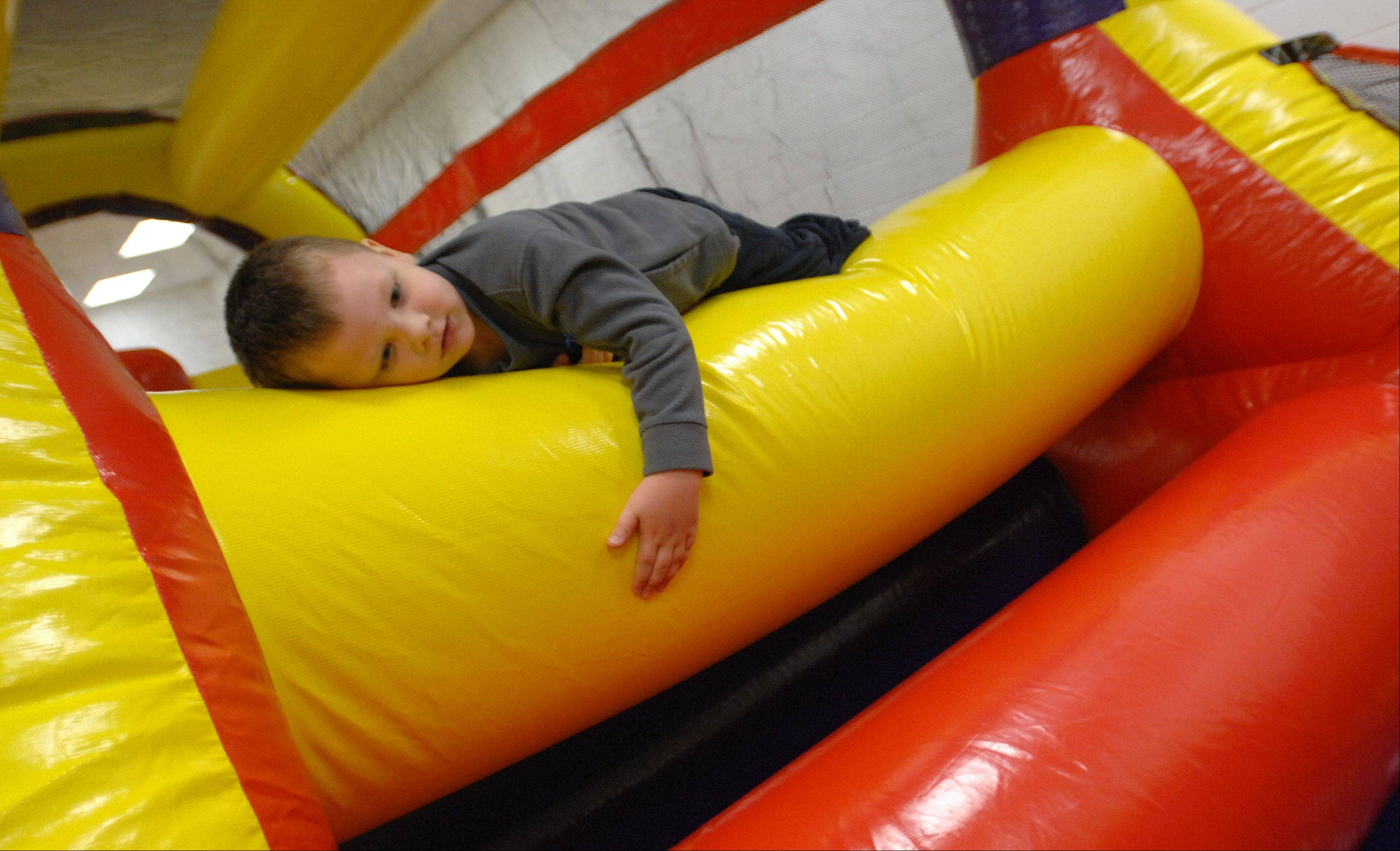Joe Wyatt, 4, of Lombard plays in the bounce house at the Take Time for Tots Day at Sunset Knoll Recreation Center in Lombard Saturday. Well over 200 people took part in this event. It offered a bounce house, story telling, and much more for children.