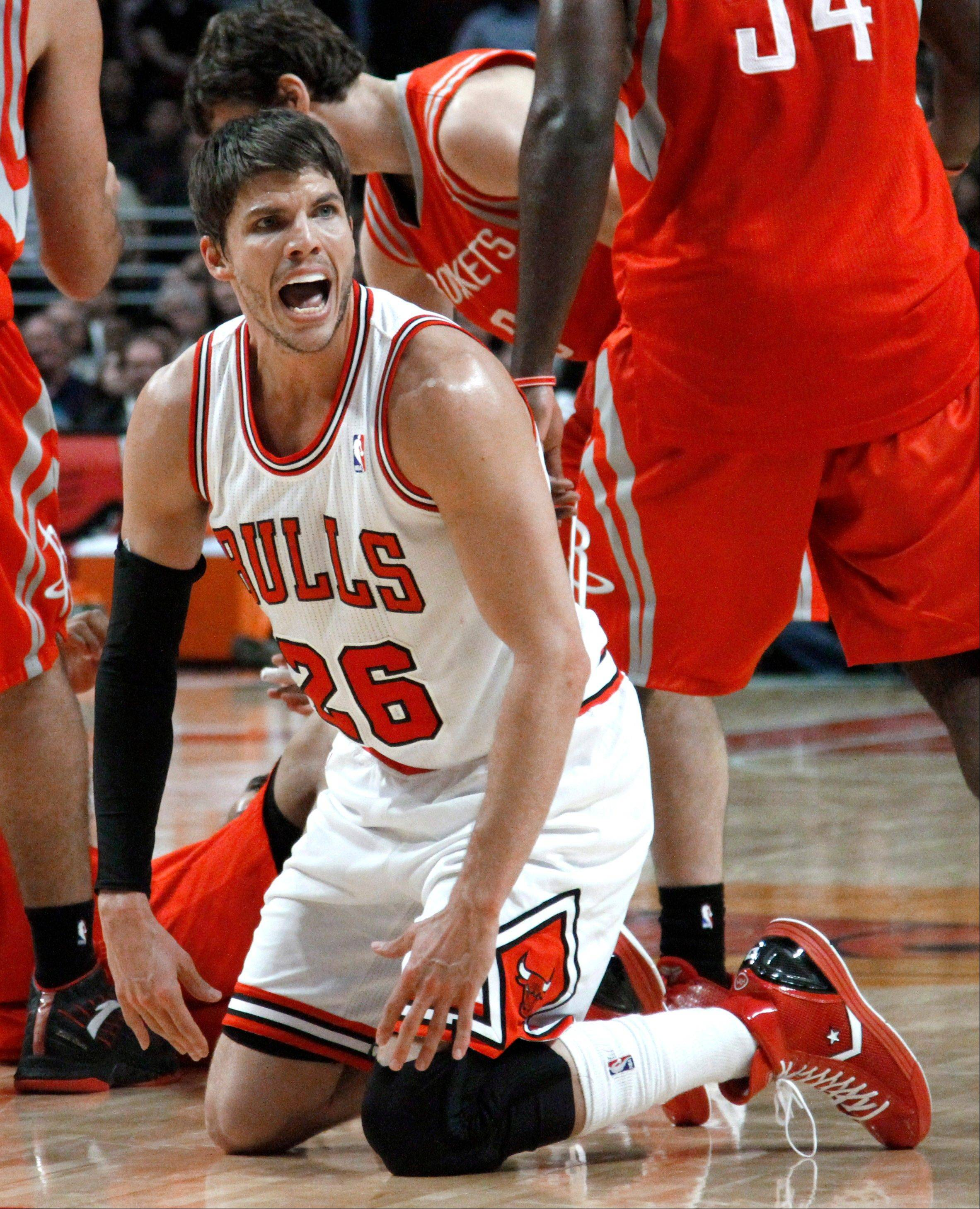 Chicago Bulls forward Kyle Korver complains to a referee after he was called for a loose ball foul, during the second half of an NBA basketball game against the Houston Rockets, Monday, April 2, 2012, in Chicago. The Rockets won 99-93.