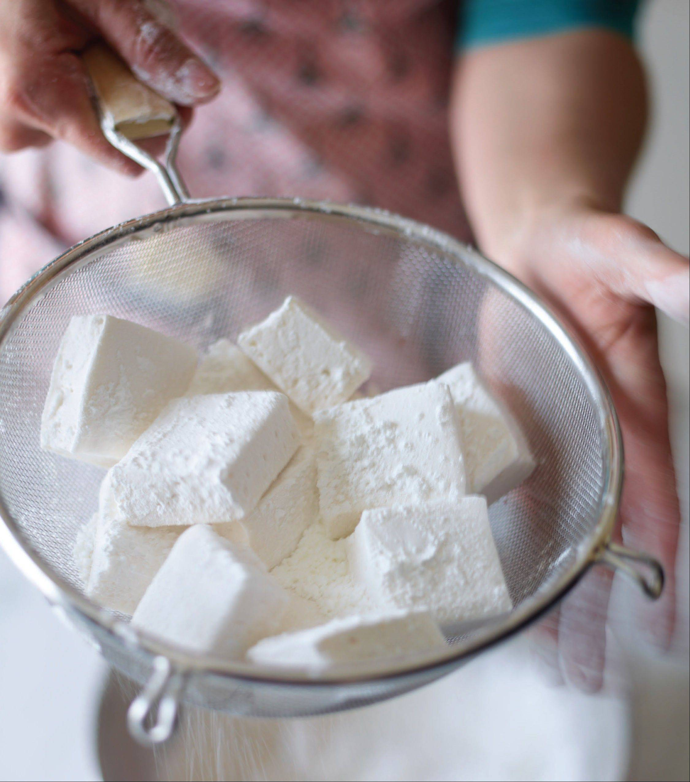 Homemade Classic Vanilla Marshmallows get tossed in a blend of powdered sugar and cornstarch so they don't stick together.