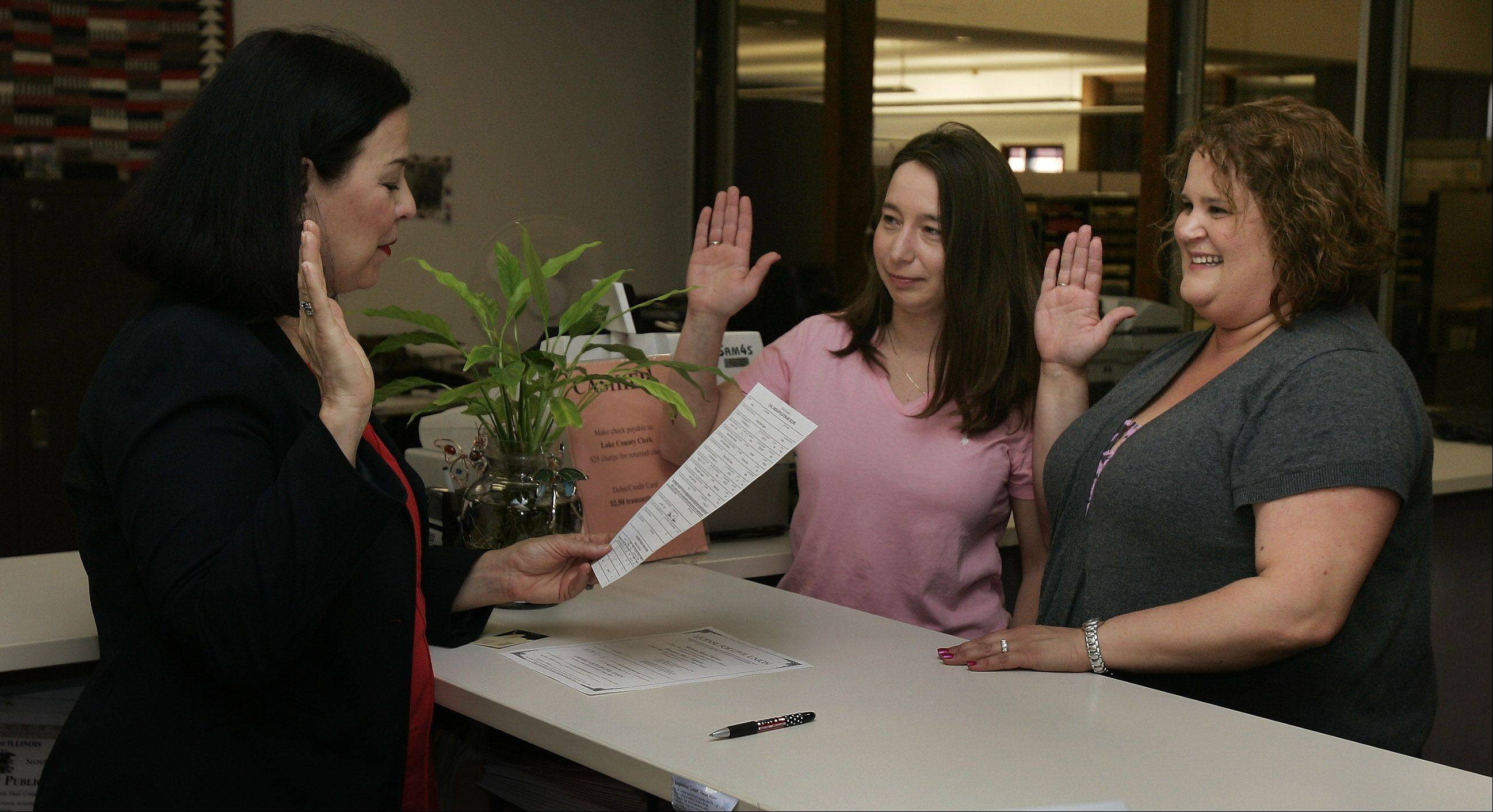 Gay, lesbian and straight couples have been able to get civil unions in Lake County and all 101 other Illinois counties since June 2011. Here, Lake County Clerk Willard Helander swears in Shannon and Michele Fagiano of Lake Villa on the first day the law was enacted.