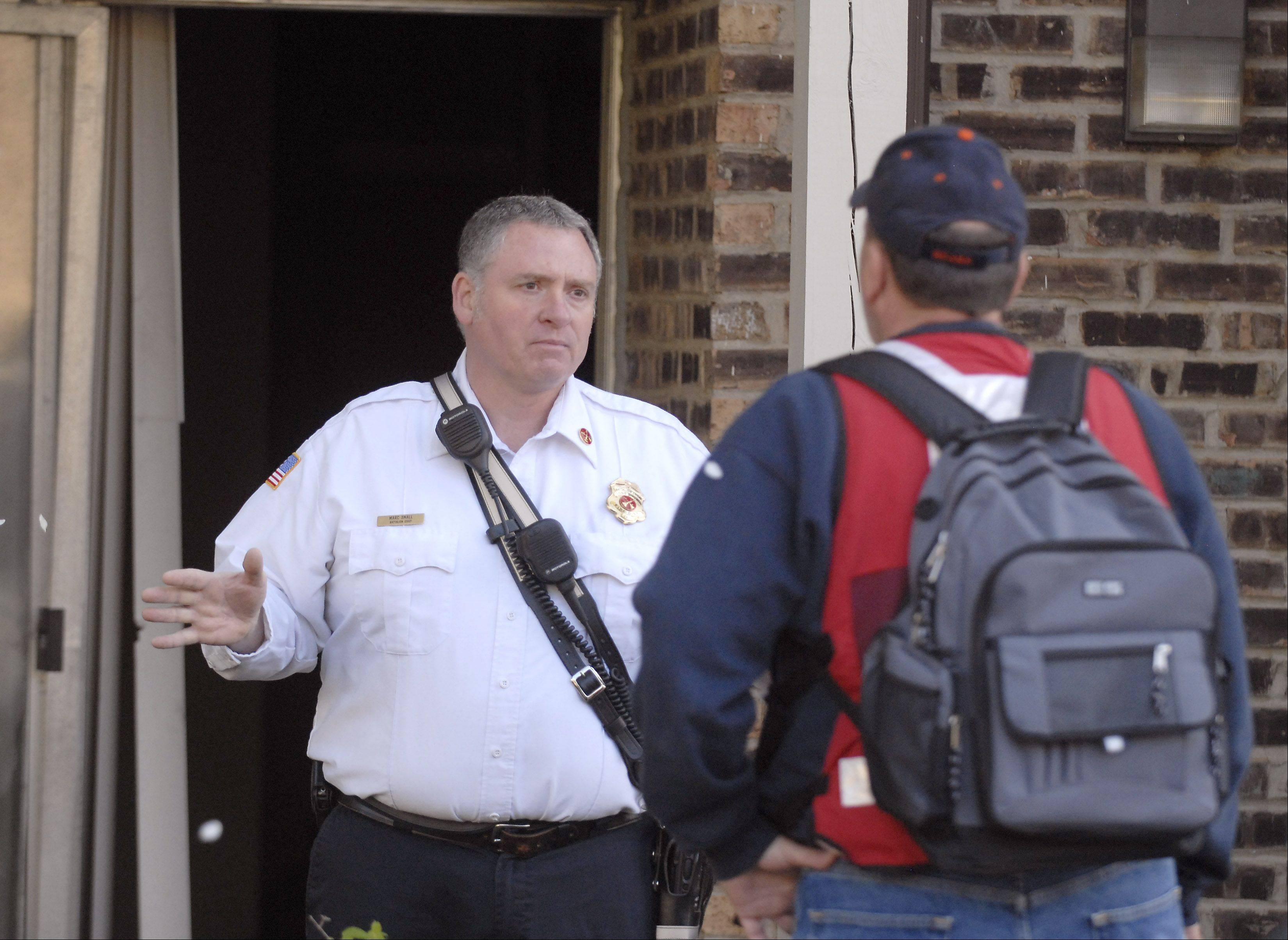 Long Grove Fire Battalion Chief Marc Small explains that residents of six apartments cannot return to their units because water and power had to be shut off after fire erupted in the utility room of the Country Glen apartment complex near Arlington Heights. The department and Red Cross worked with residents to retrieve belongings and find housing.