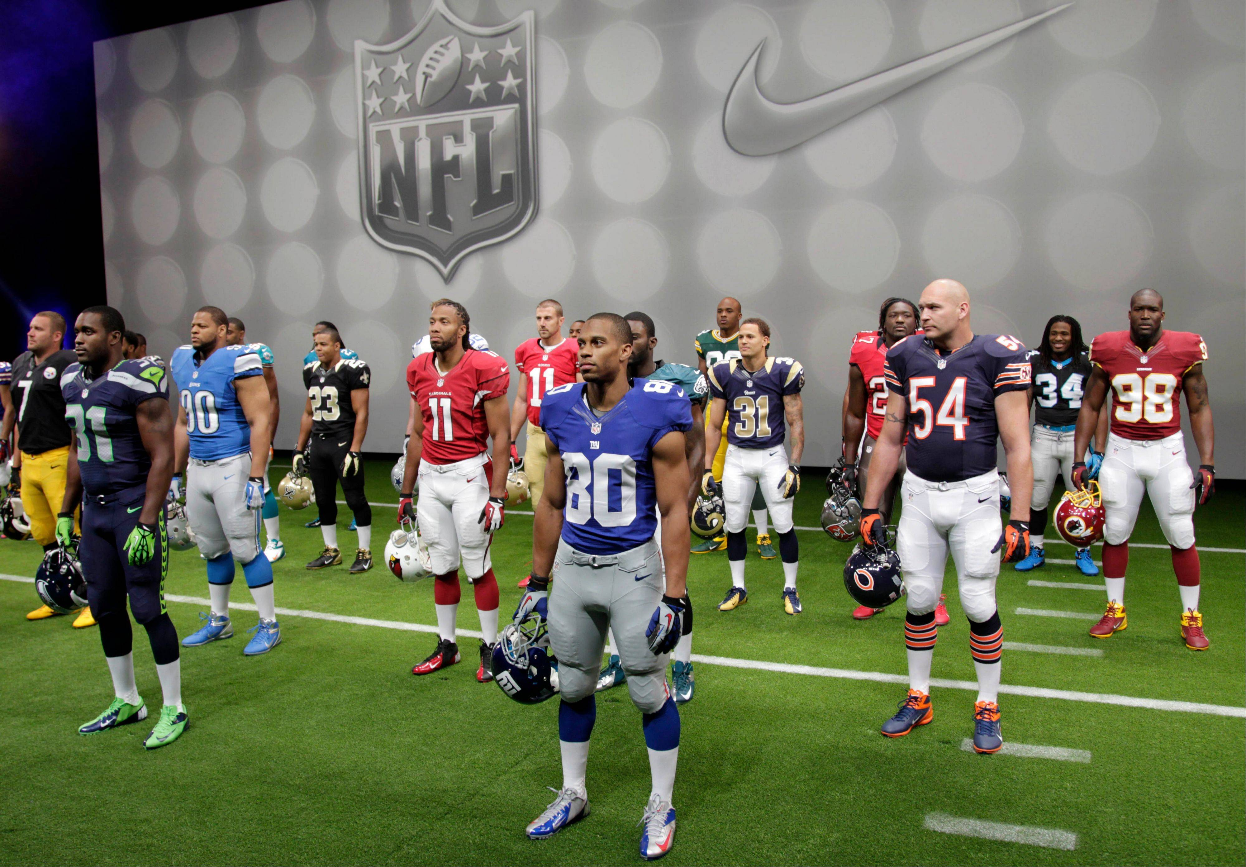 NFL players stand in their new uniforms during a presentation in New York, Tuesday, April 3, 2012. The league and Nike showed off the new look in grand style with a gridiron-styled fashion show at a Brooklyn film studio.
