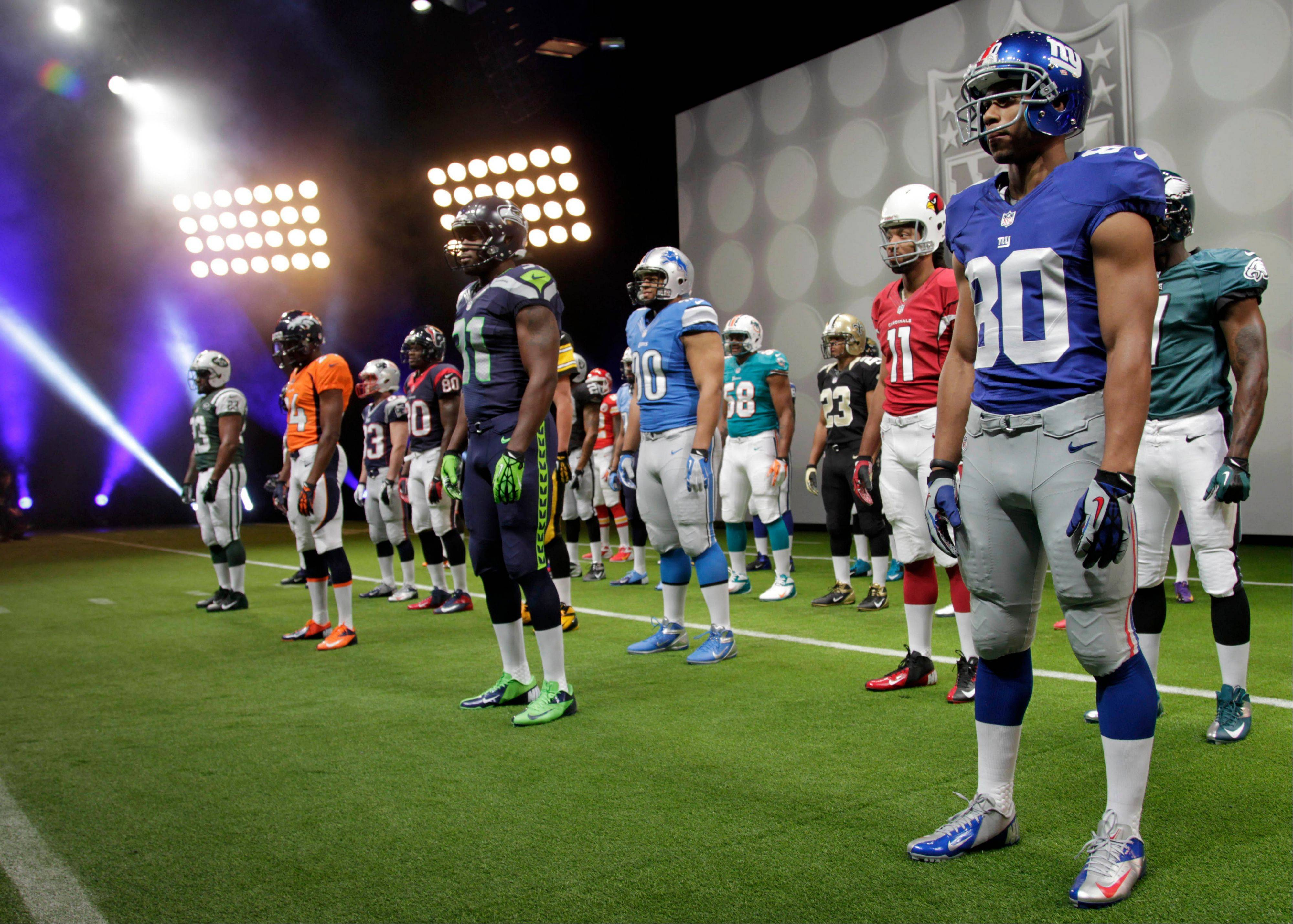 NFL uniforms are displayed during a presentation in New York, Tuesday, April 3, 2012. The league and Nike showed off the new look in grand style Tuesday with a gridiron-styled fashion show at a Brooklyn film studio.