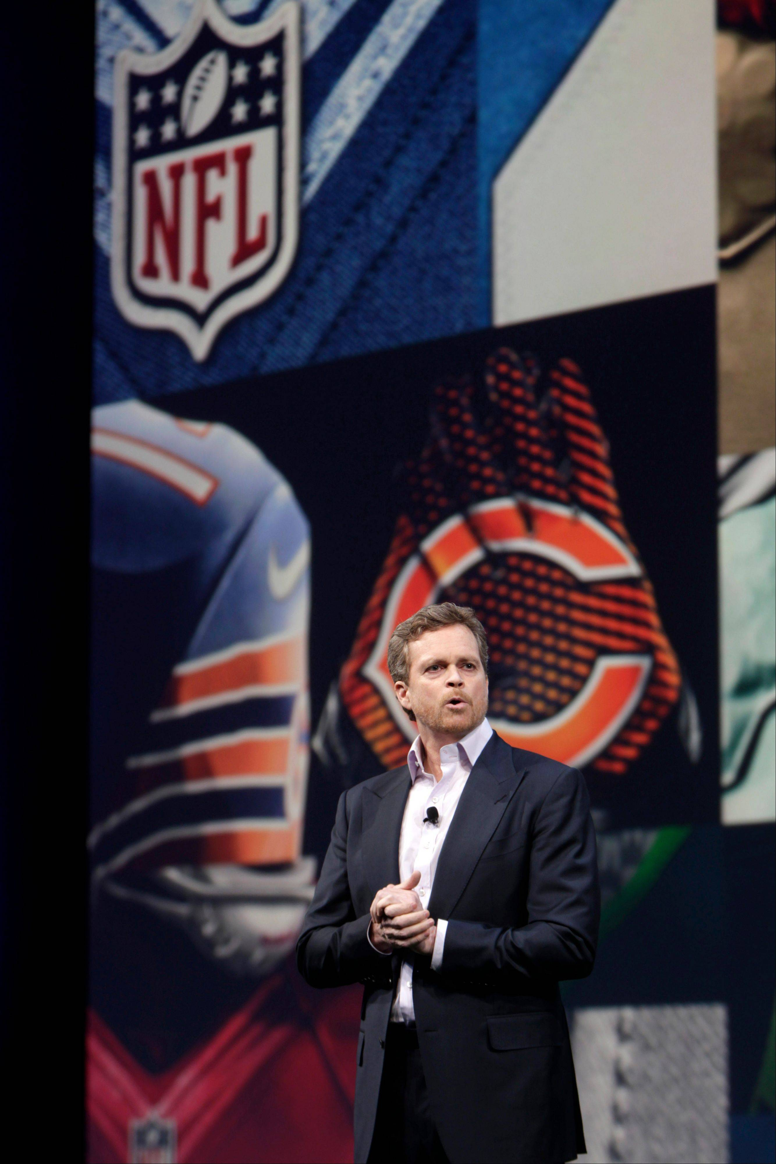 Nike CEO Mark Parker talks to guests during a presentation in New York, Tuesday, April 3, 2012. The NFL and Nike showed off the new look in grand style with a gridiron-styled fashion show at a Brooklyn film studio.