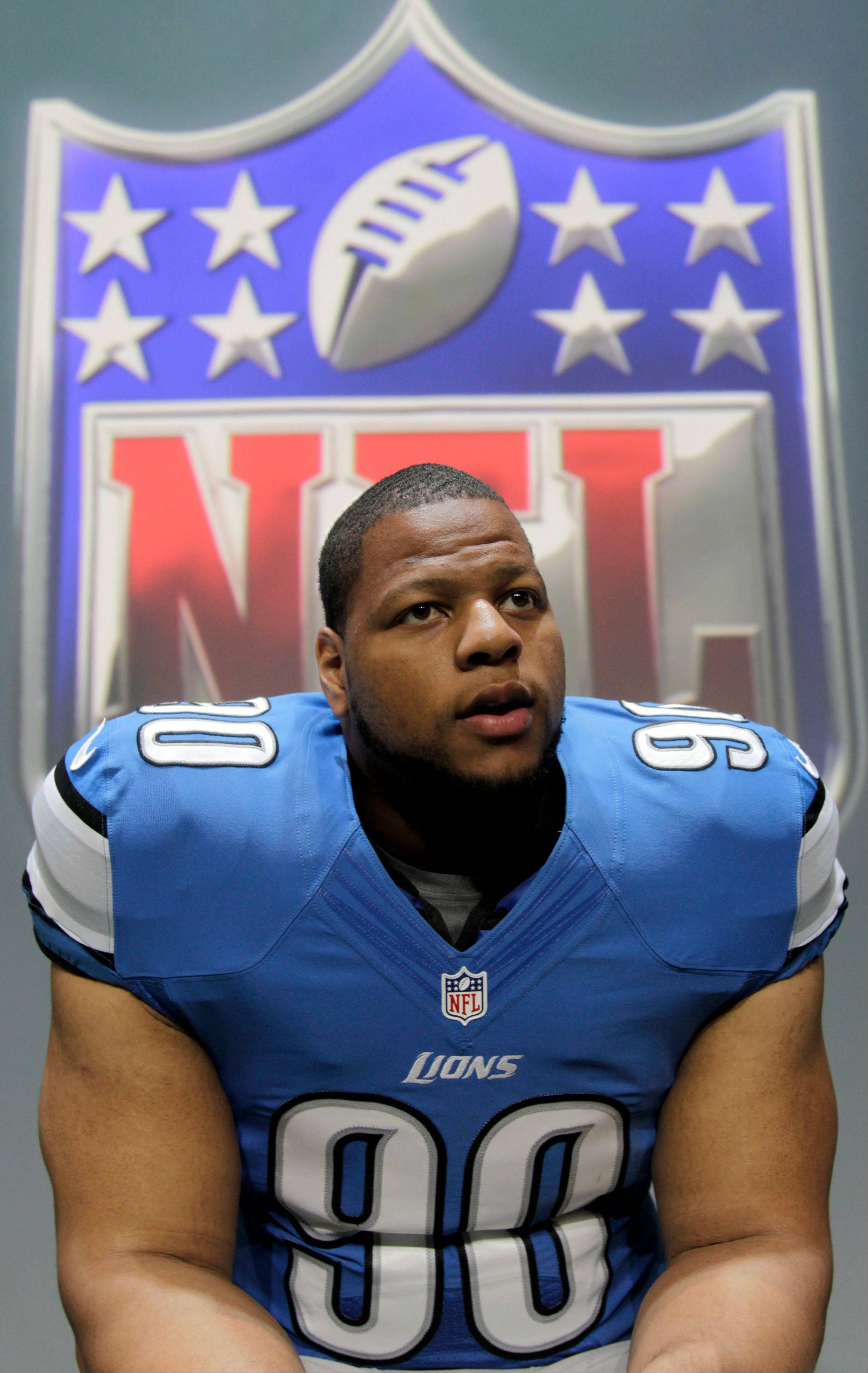 Detroit Lions' Ndamukong Suh talks to a reporter during a presentation in New York, Tuesday, April 3, 2012. The NFL and Nike showed off the new gear in grand style with a gridiron-themed fashion show at a Brooklyn film studio.