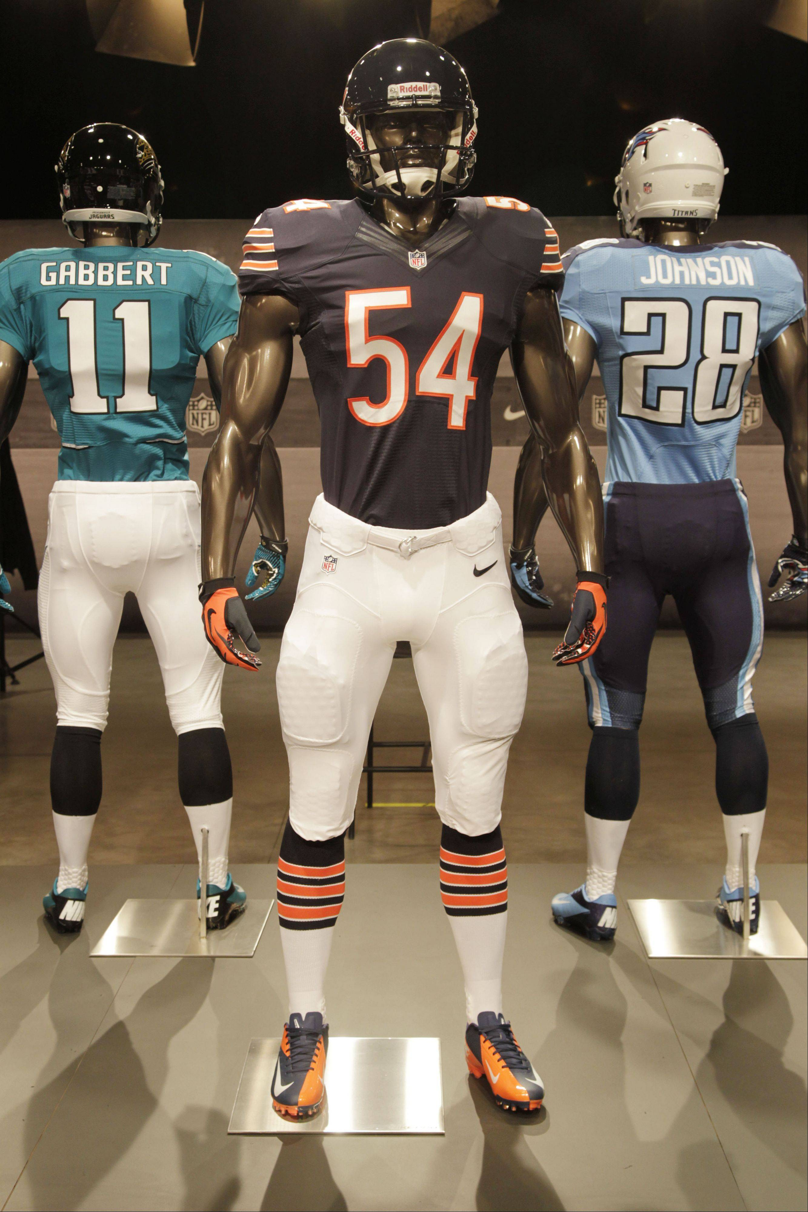 The new Chicago Bears uniform is displayed on a mannequin in New York, Tuesday, April 3, 2012. NFL has unveiled its new sleek uniforms designed by Nike. While most of the new uniforms are not very different visually, they all are made with new technology that make them lighter, dryer and more comfortable.