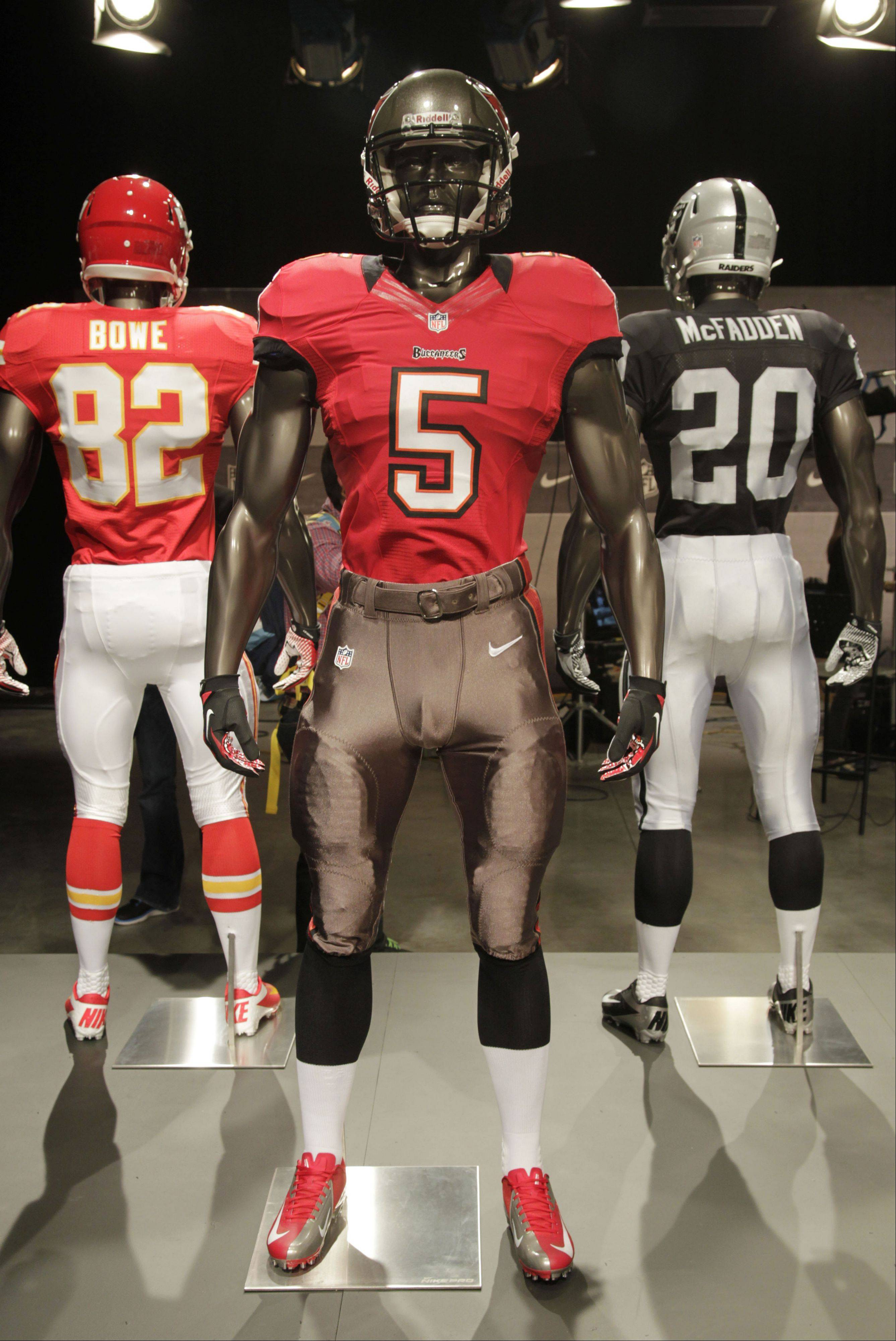 The new Tampa Bay Bucaneers uniform is displayed on a mannequin in New York, Tuesday, April 3, 2012. NFL has unveiled its new sleek uniforms designed by Nike. While most of the new uniforms are not very different visually, they all are made with new technology that make them lighter, dryer and more comfortable.