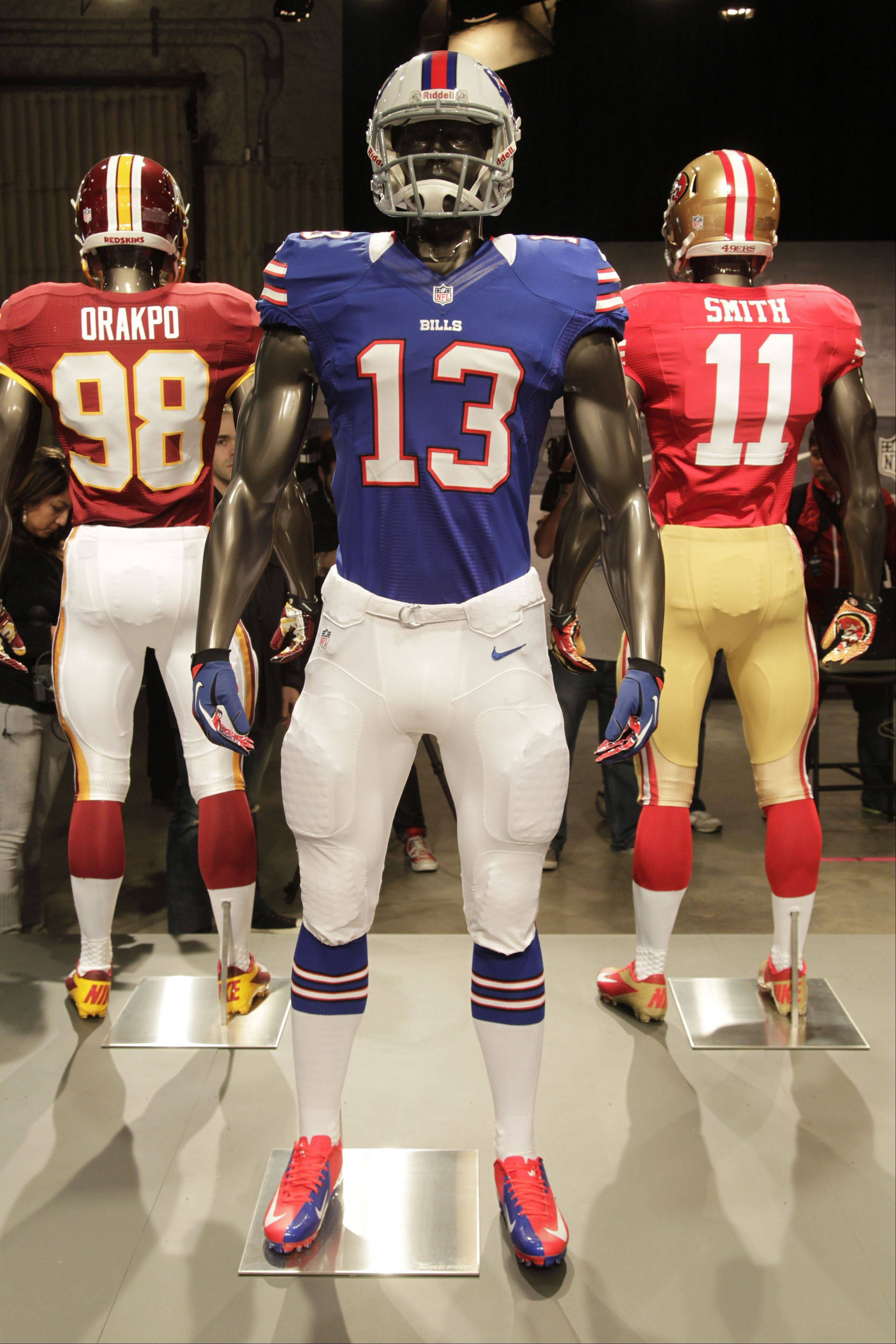 The new Buffalo Bills uniform is displayed on a mannequin in New York, Tuesday, April 3, 2012. NFL has unveiled its new sleek uniforms designed by Nike. While most of the new uniforms are not very different visually, they all are made with new technology that make them lighter, dryer and more comfortable.
