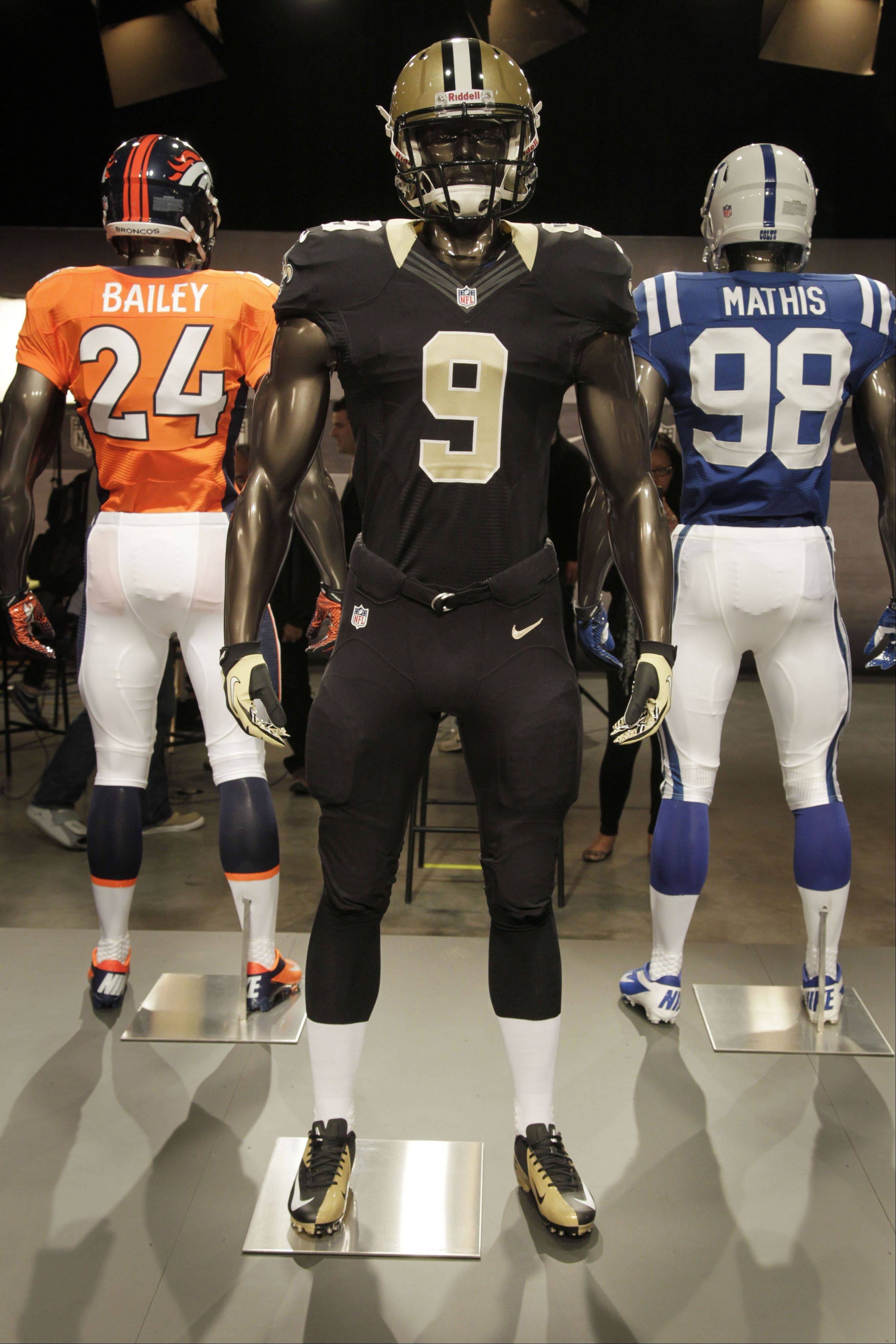 The new New Orleans Saints uniform is displayed on a mannequin in New York, Tuesday, April 3, 2012. NFL has unveiled its new sleek uniforms designed by Nike. While most of the new uniforms are not very different visually, they all are made with new technology that make them lighter, dryer and more comfortable.