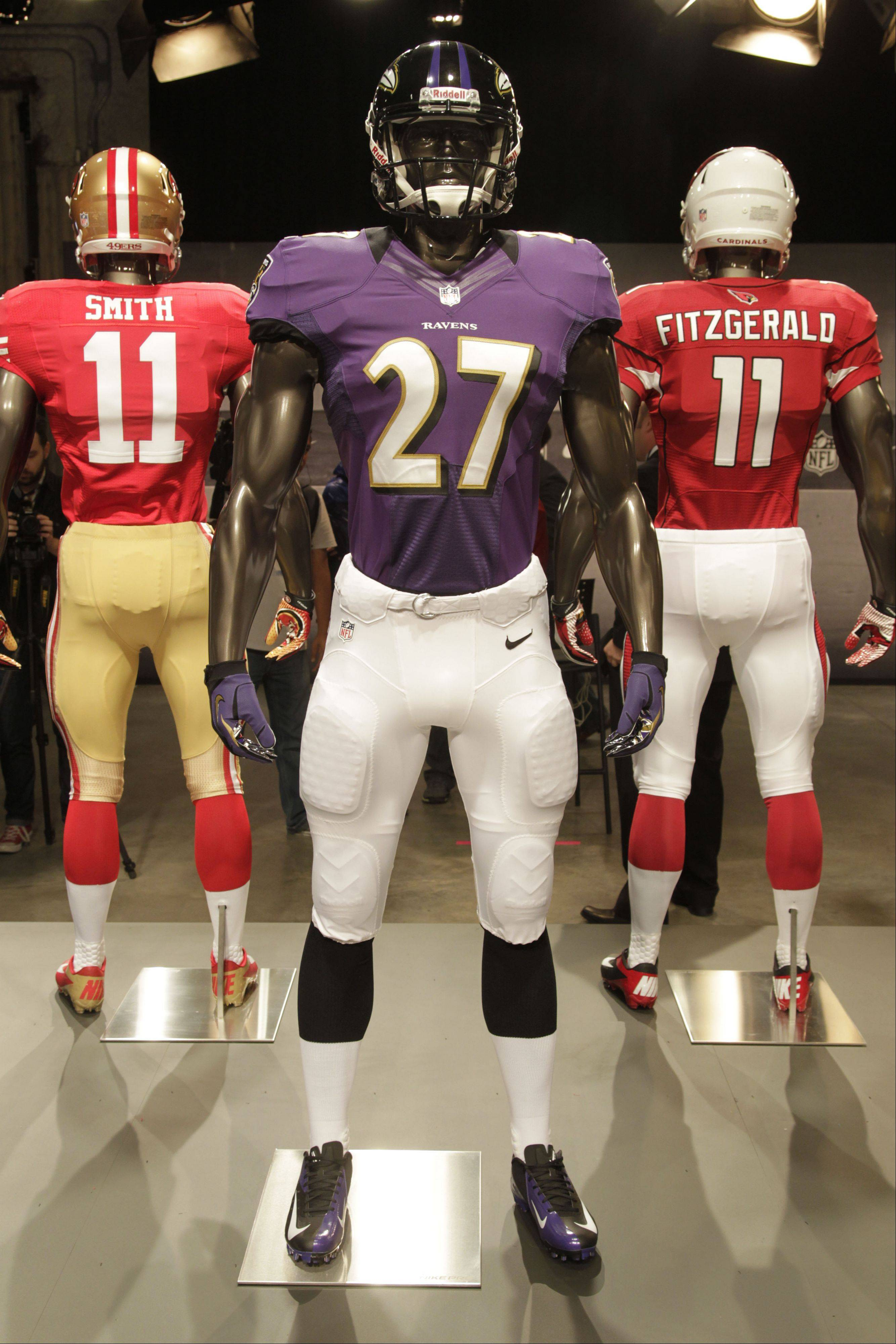 The new Baltimore Ravens uniform is displayed on a mannequin in New York, Tuesday, April 3, 2012. NFL has unveiled its new sleek uniforms designed by Nike. While most of the new uniforms are not very different visually, they all are made with new technology that make them lighter, dryer and more comfortable.