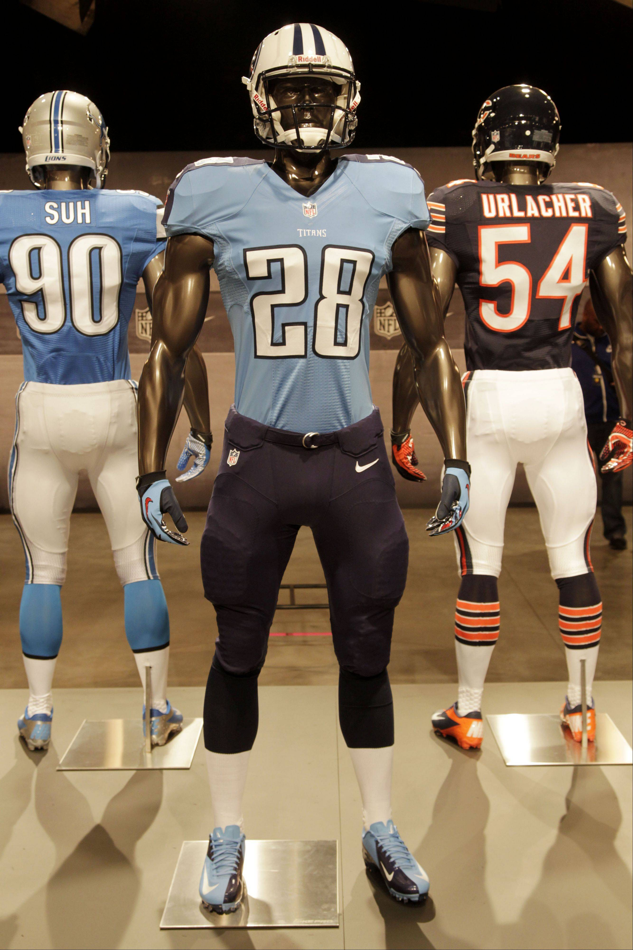 The new Tennessee Titans uniform is displayed on a mannequin in New York, Tuesday, April 3, 2012. NFL has unveiled its new sleek uniforms designed by Nike. While most of the new uniforms are not very different visually, they all are made with new technology that make them lighter, dryer and more comfortable.