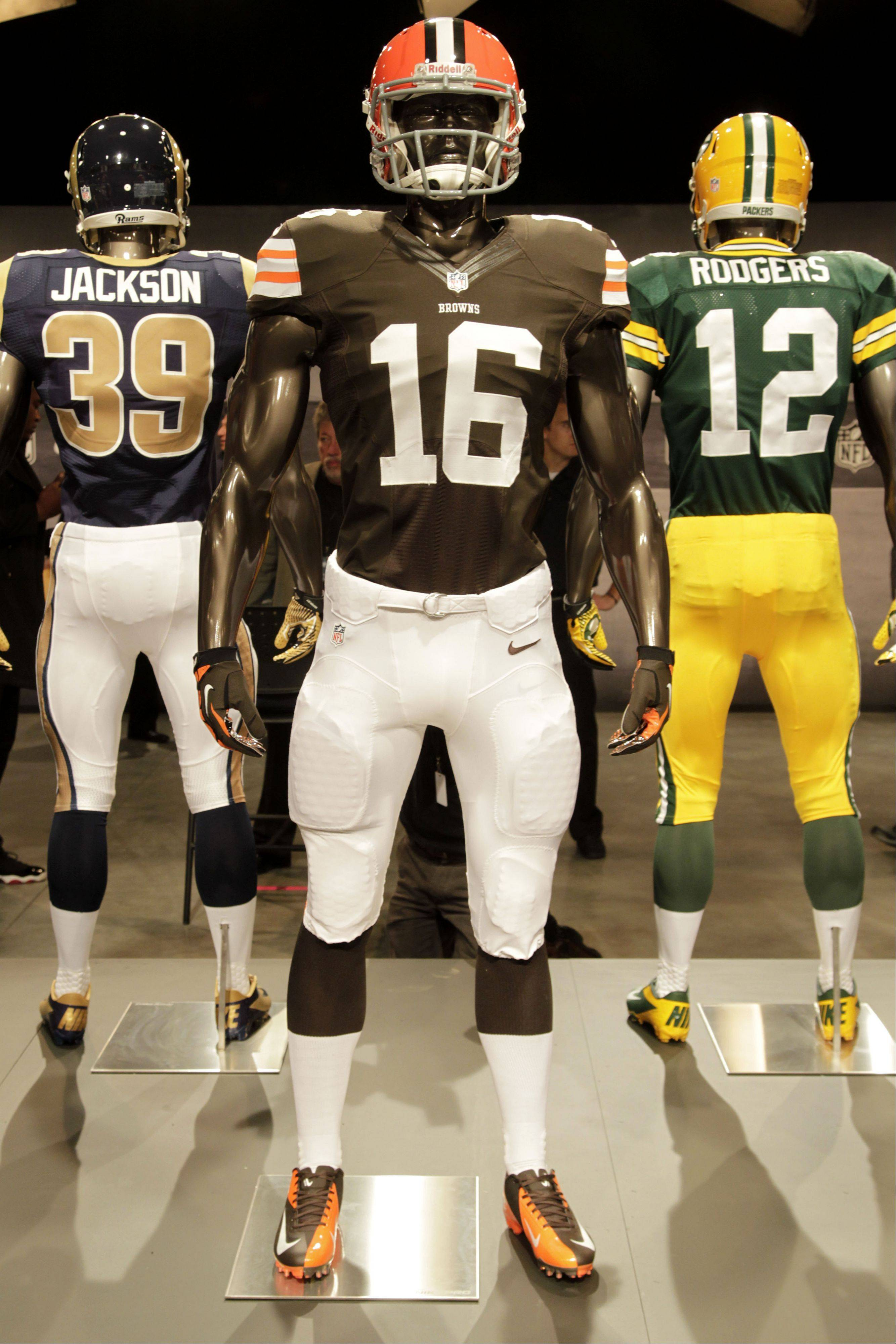 The new Cleveland Browns uniform is displayed on a mannequin in New York, Tuesday, April 3, 2012. NFL has unveiled its new sleek uniforms designed by Nike. While most of the new uniforms are not very different visually, they all are made with new technology that make them lighter, dryer and more comfortable.