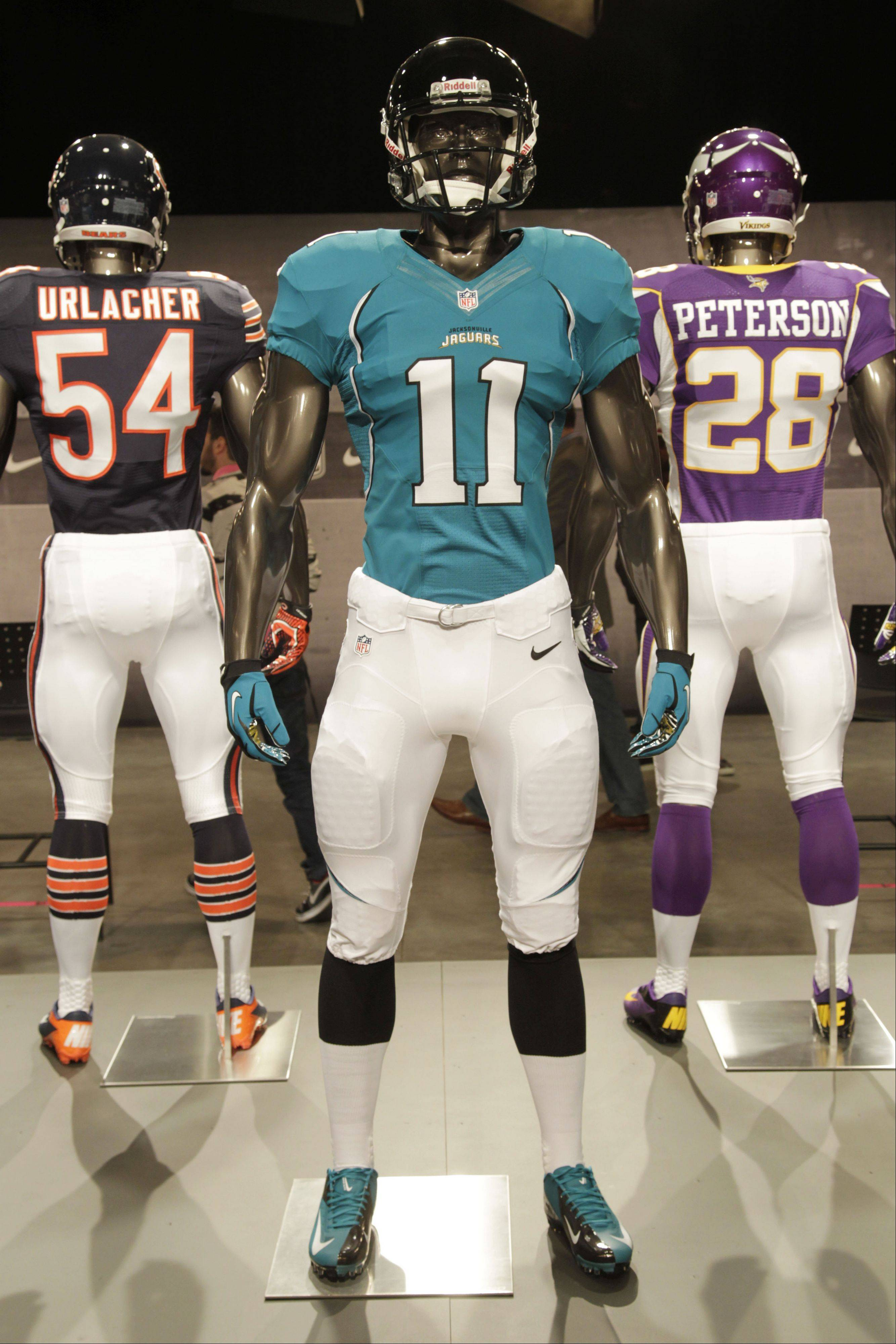 The new Jacksonville Jaguars uniform is displayed on a mannequin in New York, Tuesday, April 3, 2012. NFL has unveiled its new sleek uniforms designed by Nike. While most of the new uniforms are not very different visually, they all are made with new technology that make them lighter, dryer and more comfortable.