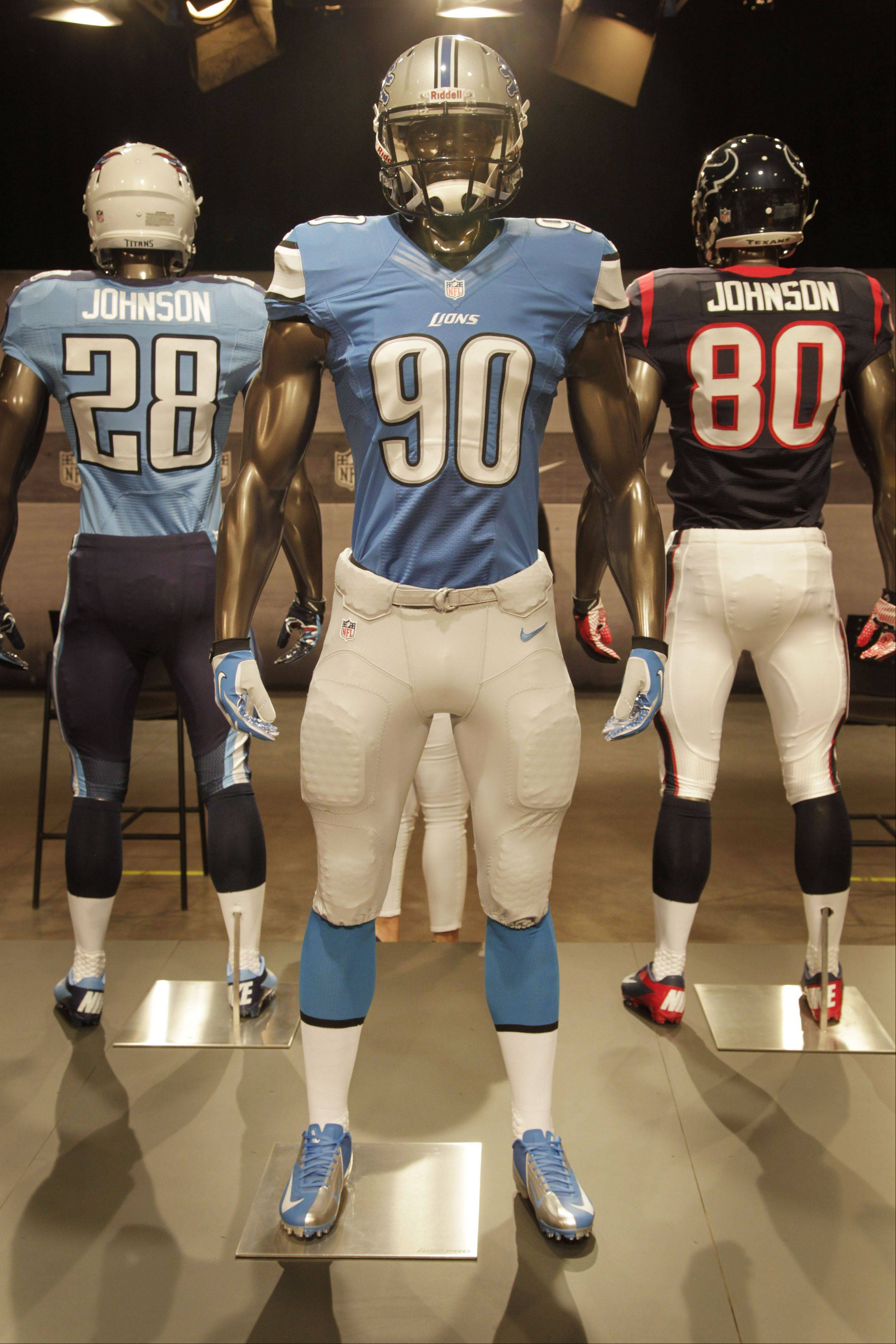 The new Detroit Lions uniform is displayed on a mannequin in New York, Tuesday, April 3, 2012. NFL has unveiled its new sleek uniforms designed by Nike. While most of the new uniforms are not very different visually, they all are made with new technology that make them lighter, dryer and more comfortable.