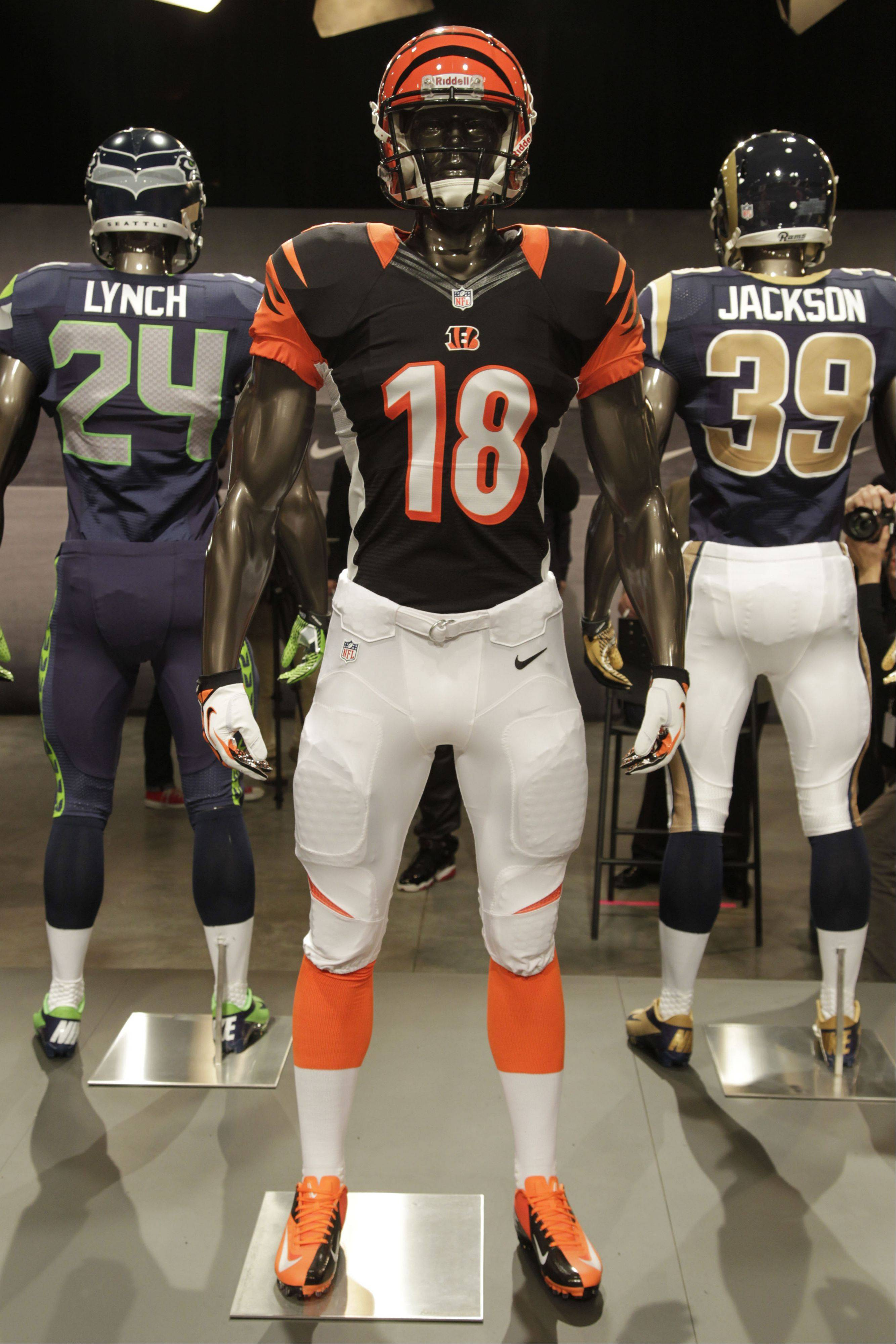 The new Cincinnati Bengals uniform is displayed on a mannequin in New York, Tuesday, April 3, 2012. NFL has unveiled its new sleek uniforms designed by Nike. While most of the new uniforms are not very different visually, they all are made with new technology that make them lighter, dryer and more comfortable.