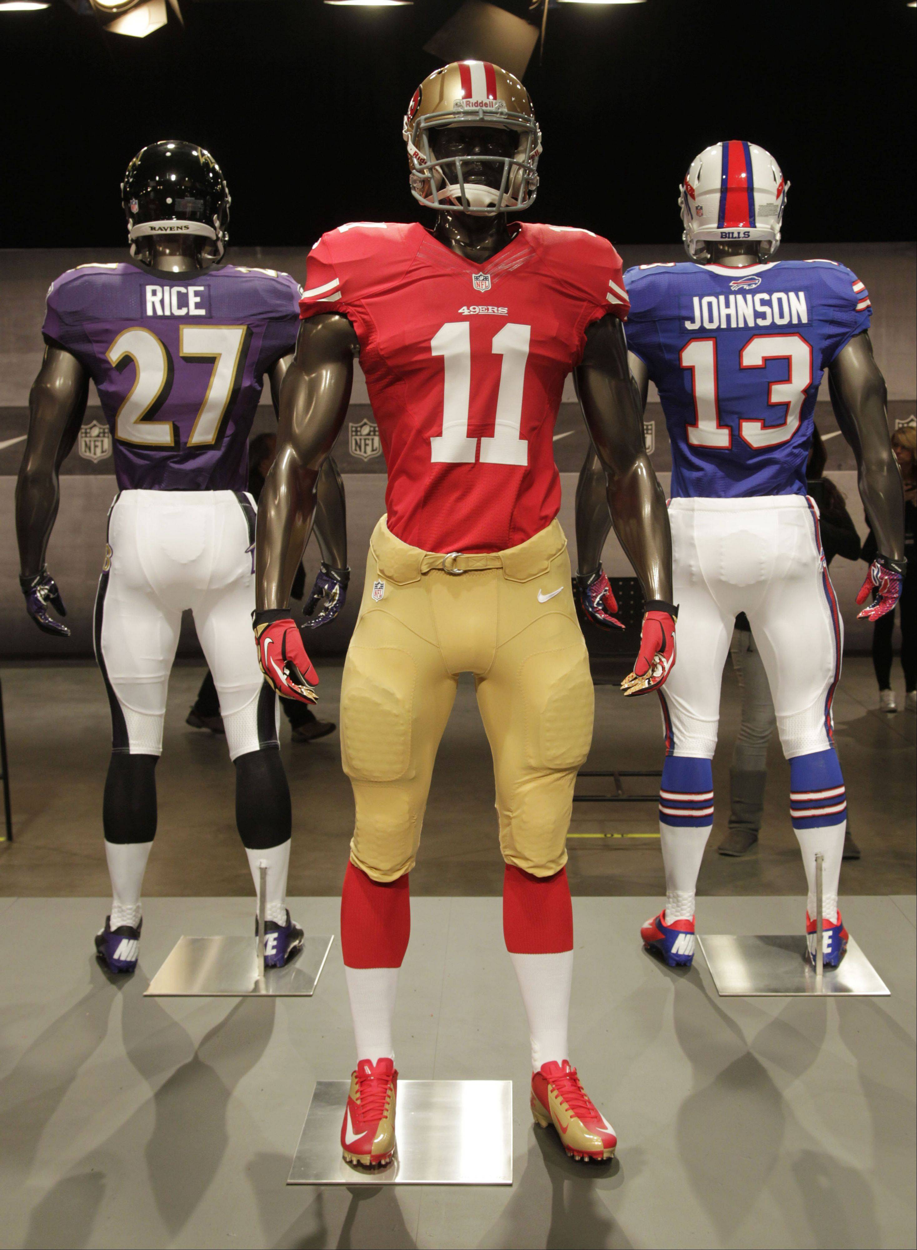 The new San Francisco 49ers uniform is displayed on a mannequin in New York, Tuesday, April 3, 2012. NFL has unveiled its new sleek uniforms designed by Nike. While most of the new uniforms are not very different visually, they all are made with new technology that make them lighter, dryer and more comfortable.