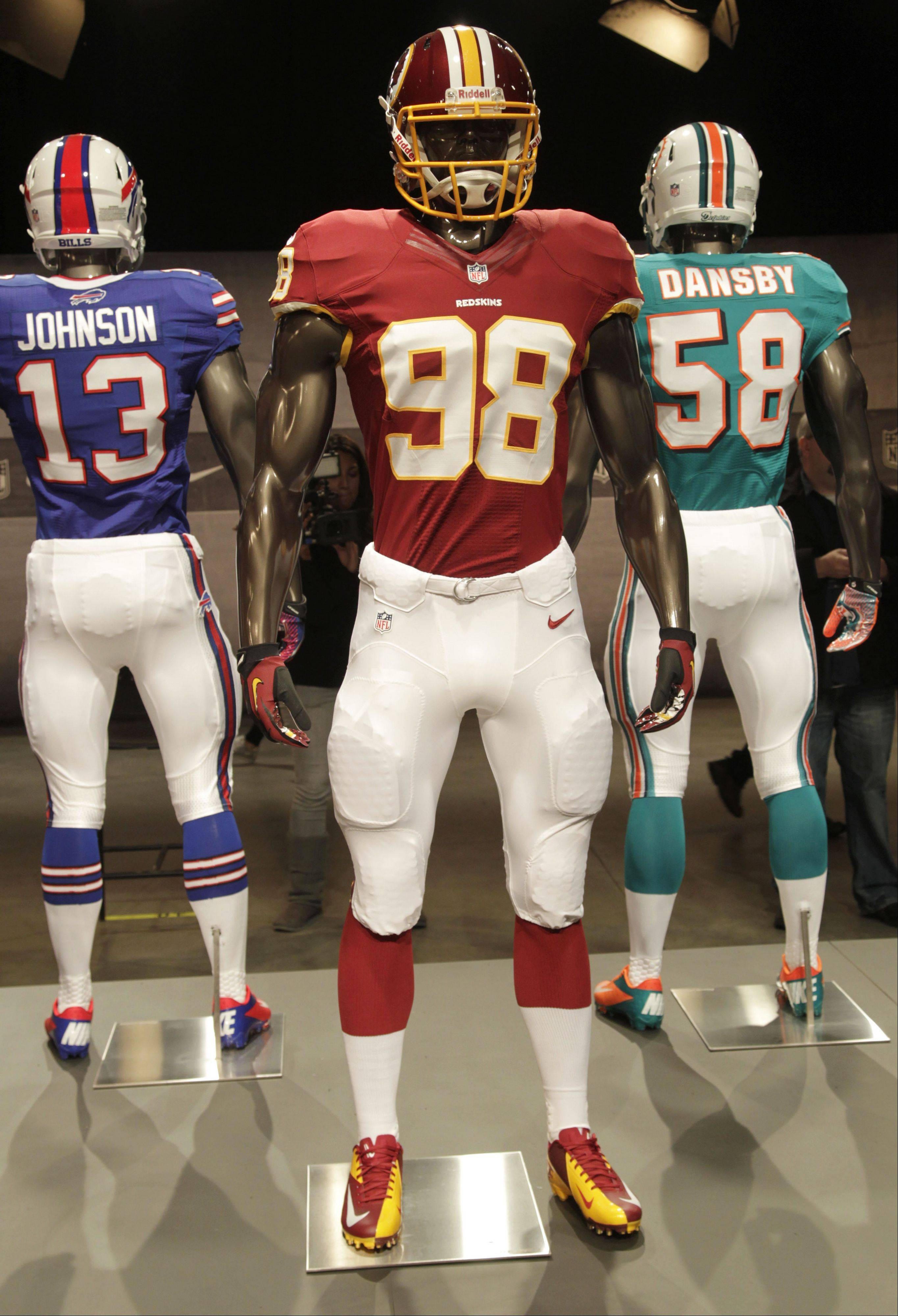 The new Washington Redskins uniform is displayed on a mannequin in New York, Tuesday, April 3, 2012. NFL has unveiled its new sleek uniforms designed by Nike. While most of the new uniforms are not very different visually, they all are made with new technology that make them lighter, dryer and more comfortable.