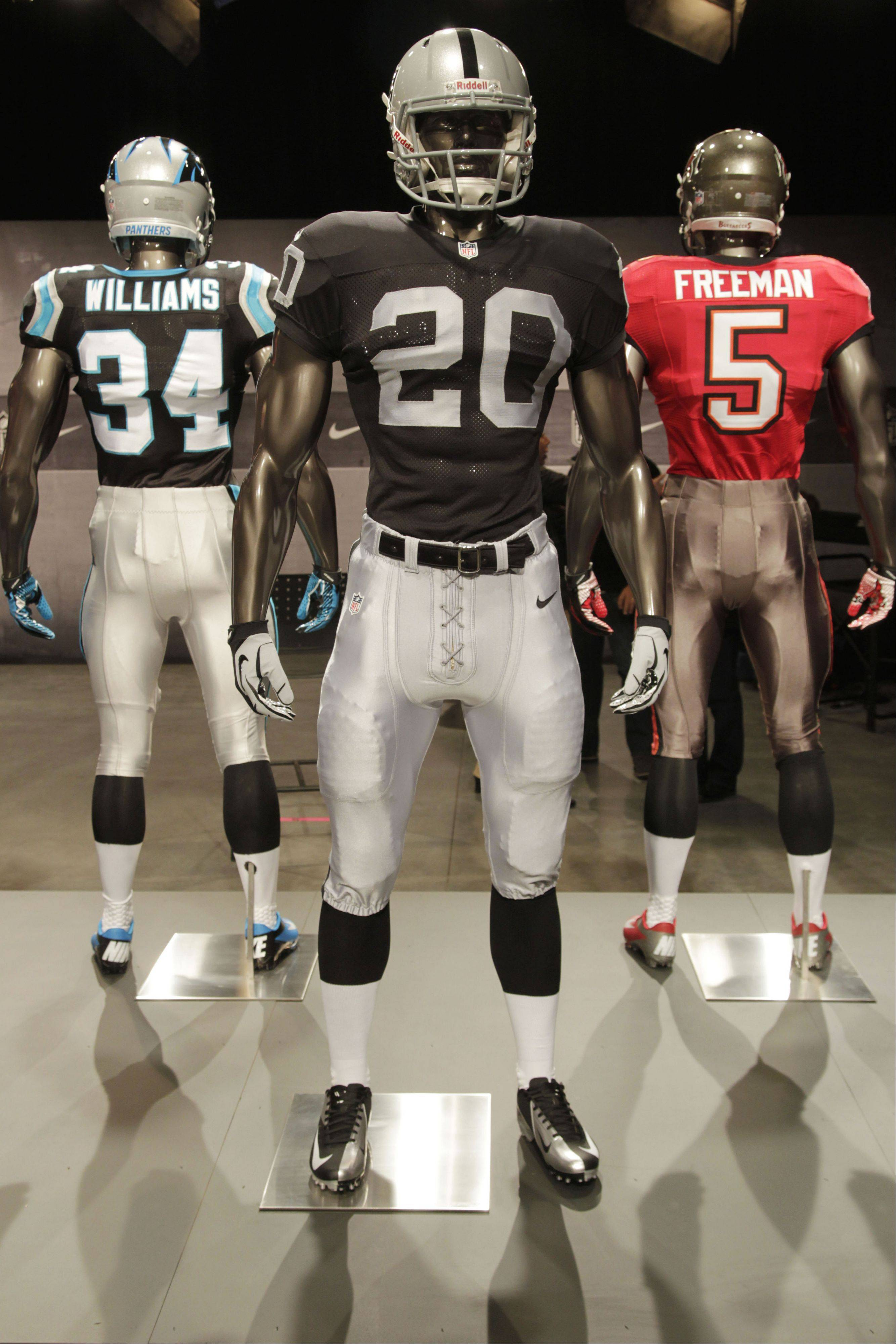 The new Oakland Raiders uniform is displayed on a mannequin in New York, Tuesday, April 3, 2012. NFL has unveiled its new sleek uniforms designed by Nike. While most of the new uniforms are not very different visually, they all are made with new technology that make them lighter, dryer and more comfortable.