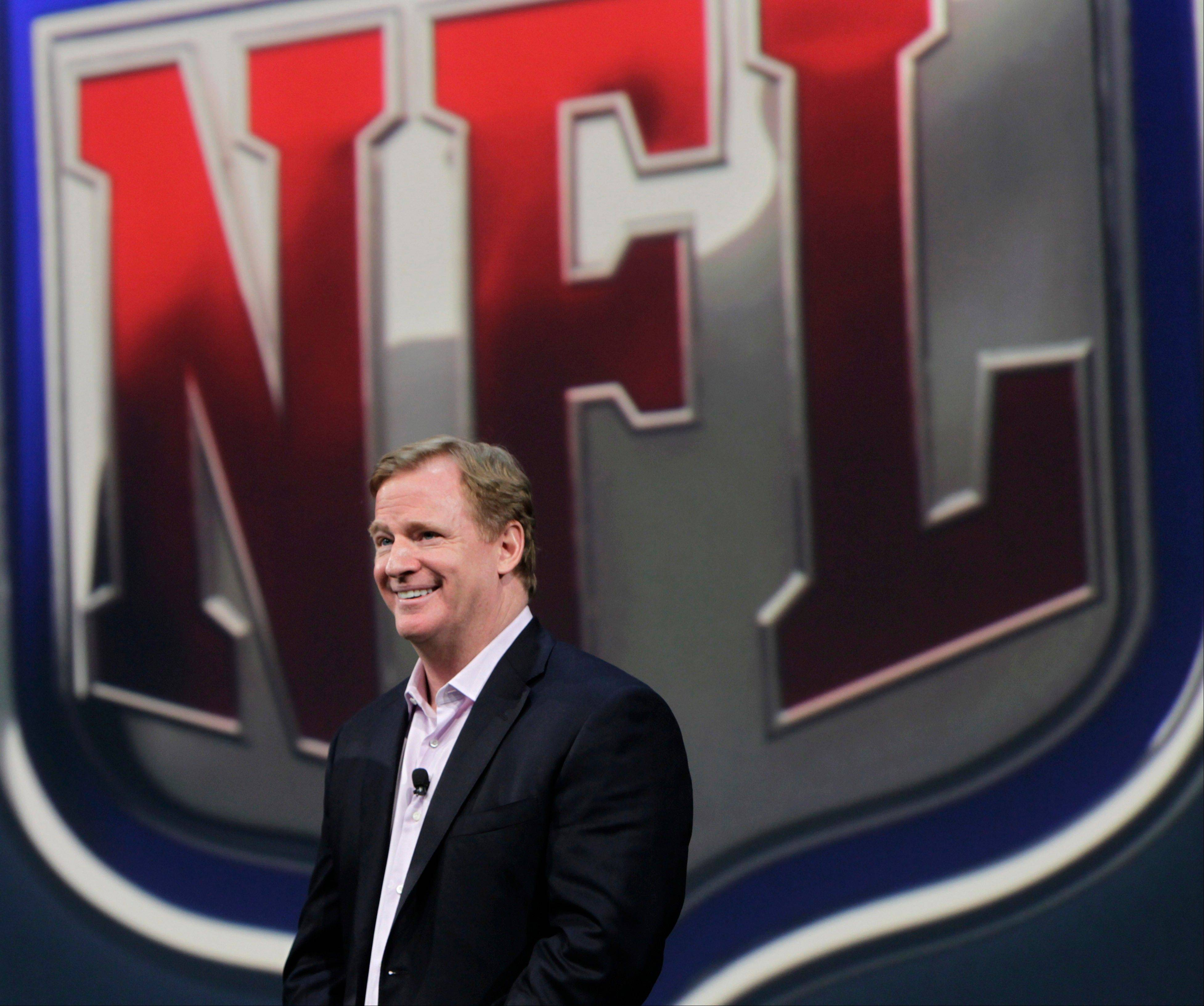 NFL Commissioner Roger Goodell smiles during a presentation in New York, Tuesday, April 3, 2012. The league and Nike showed off the new look in grand style with a gridiron-styled fashion show at a Brooklyn film studio.