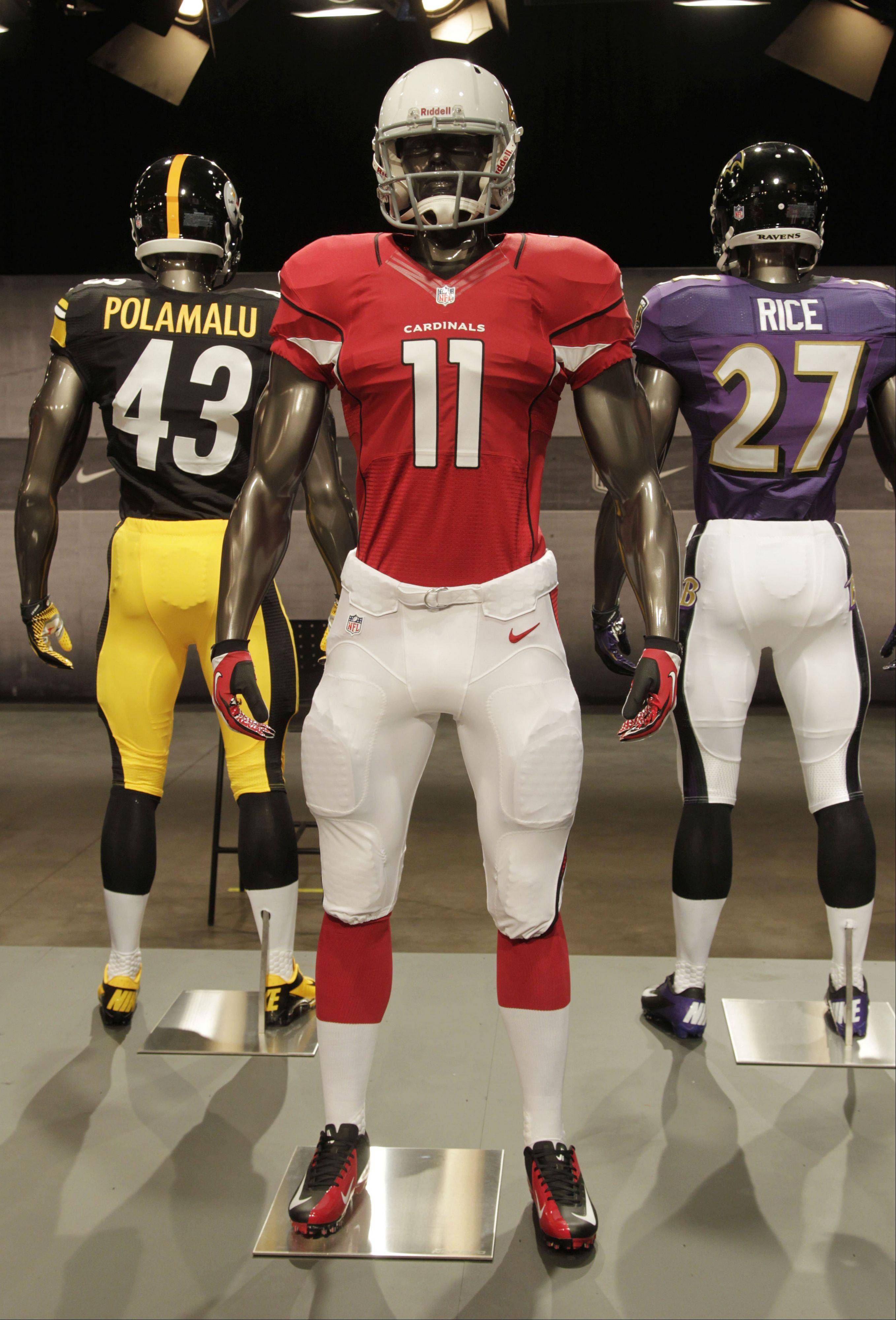 The new Arizona Cardinals uniform is displayed on a mannequin in New York, Tuesday, April 3, 2012. NFL has unveiled its new sleek uniforms designed by Nike. While most of the new uniforms are not very different visually, they all are made with new technology that make them lighter, dryer and more comfortable.