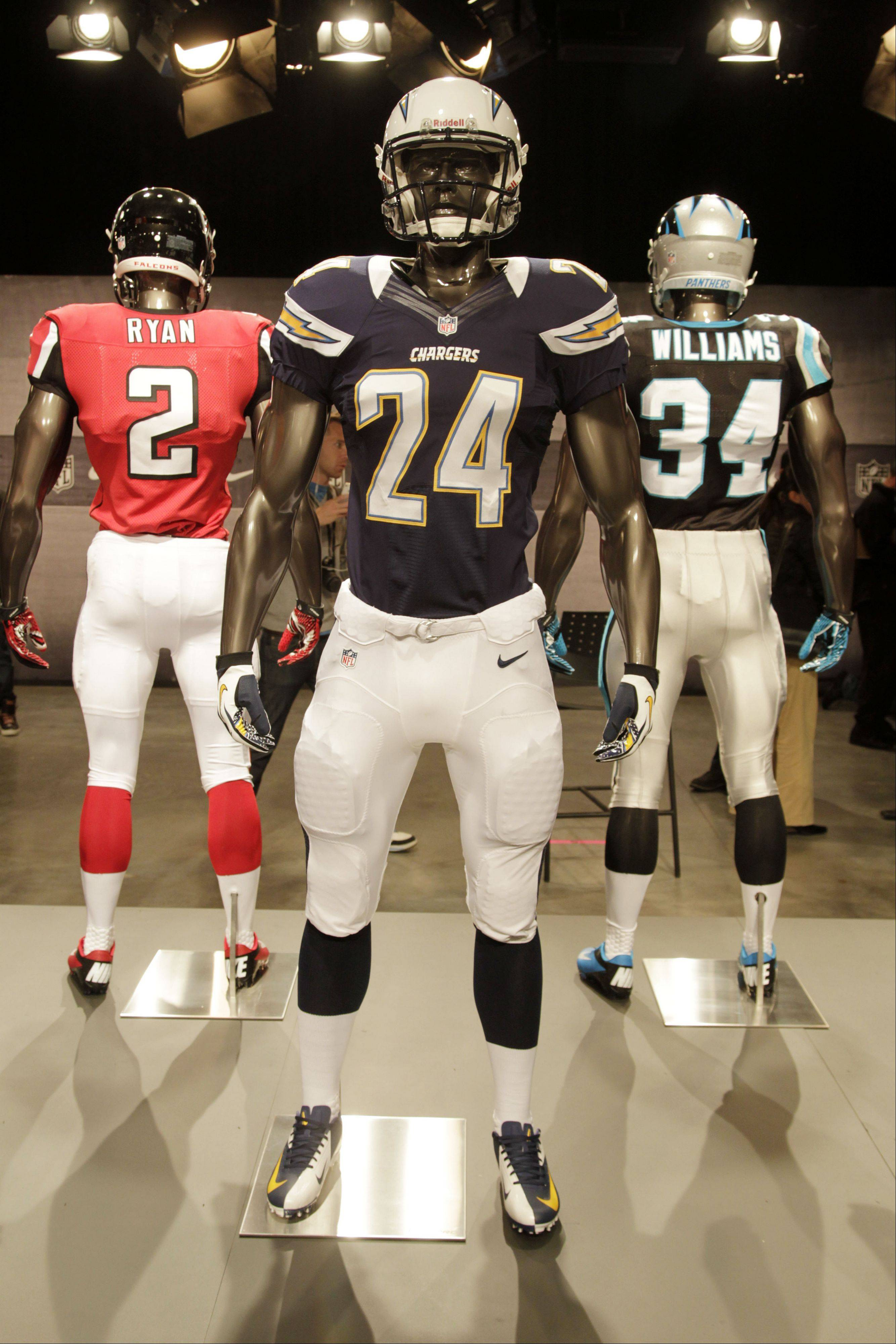 The new San Diego Chargers uniform is displayed on a mannequin in New York, Tuesday, April 3, 2012. NFL has unveiled its new sleek uniforms designed by Nike. While most of the new uniforms are not very different visually, they all are made with new technology that make them lighter, dryer and more comfortable.