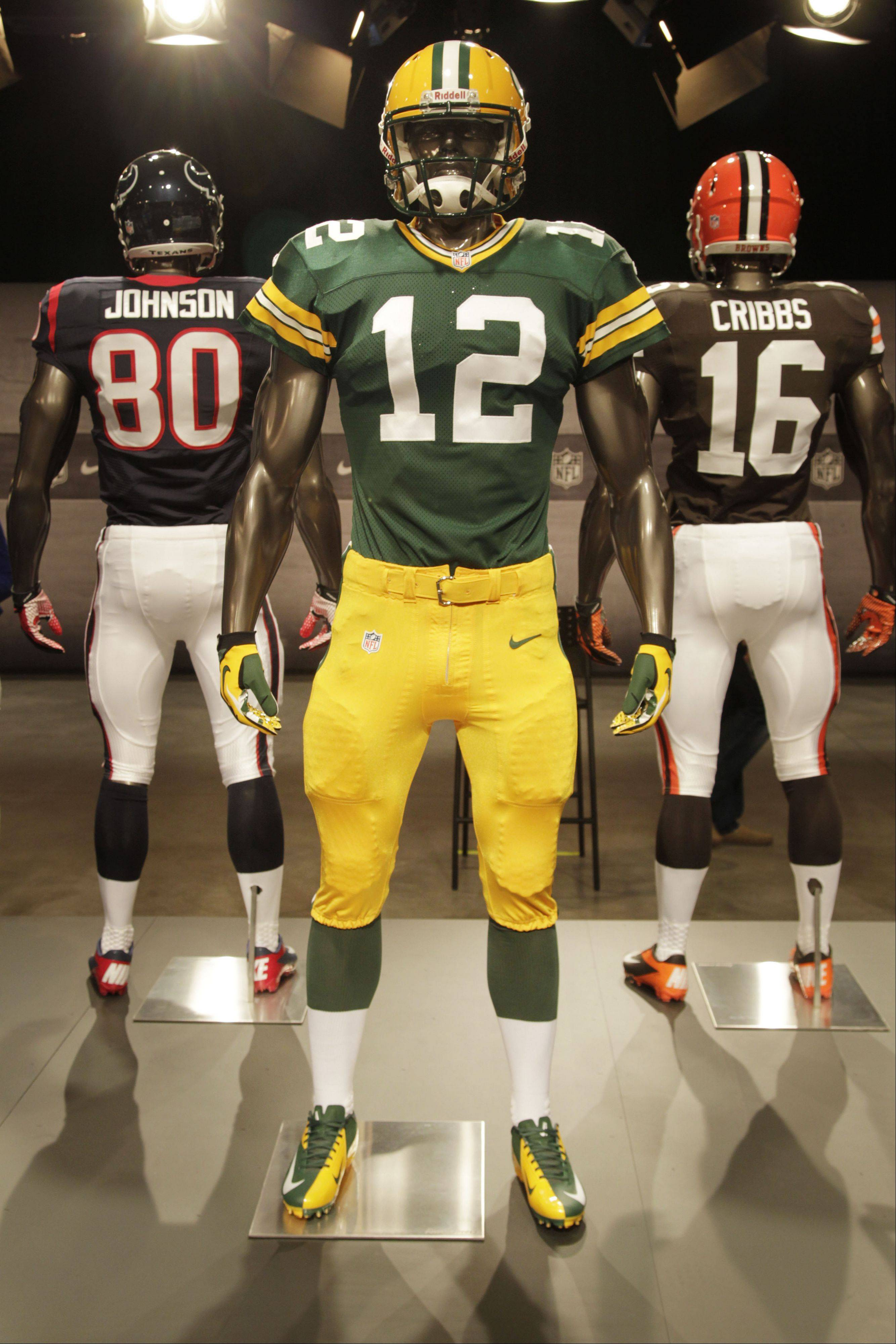 The new Green Bay Packers uniform is displayed on a mannequin in New York, Tuesday, April 3, 2012. NFL has unveiled its new sleek uniforms designed by Nike. While most of the new uniforms are not very different visually, they all are made with new technology that make them lighter, dryer and more comfortable.