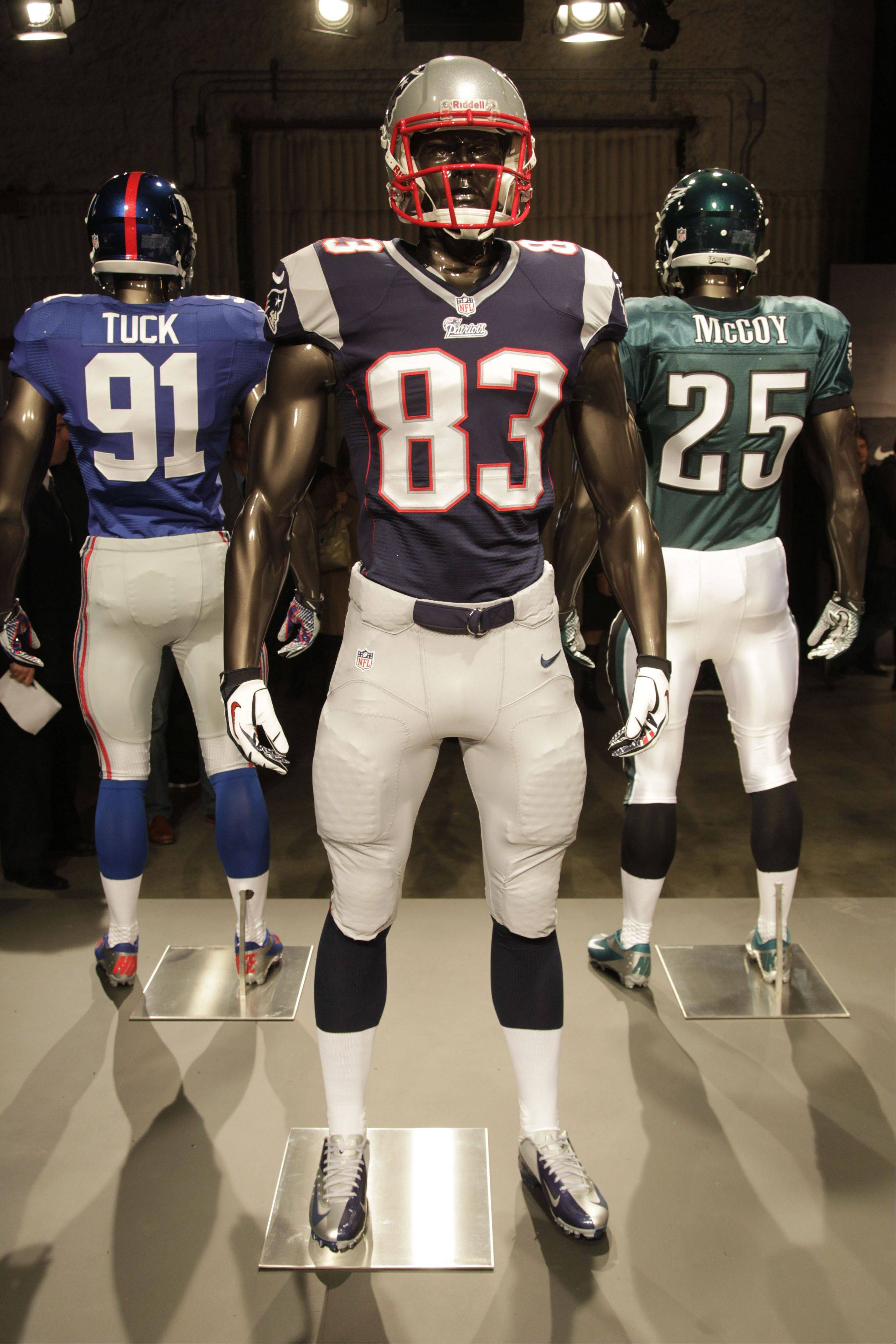 The new New England Patriots uniform is displayed on a mannequin in New York, Tuesday, April 3, 2012. NFL has unveiled its new sleek uniforms designed by Nike. While most of the new uniforms are not very different visually, they all are made with new technology that make them lighter, dryer and more comfortable.