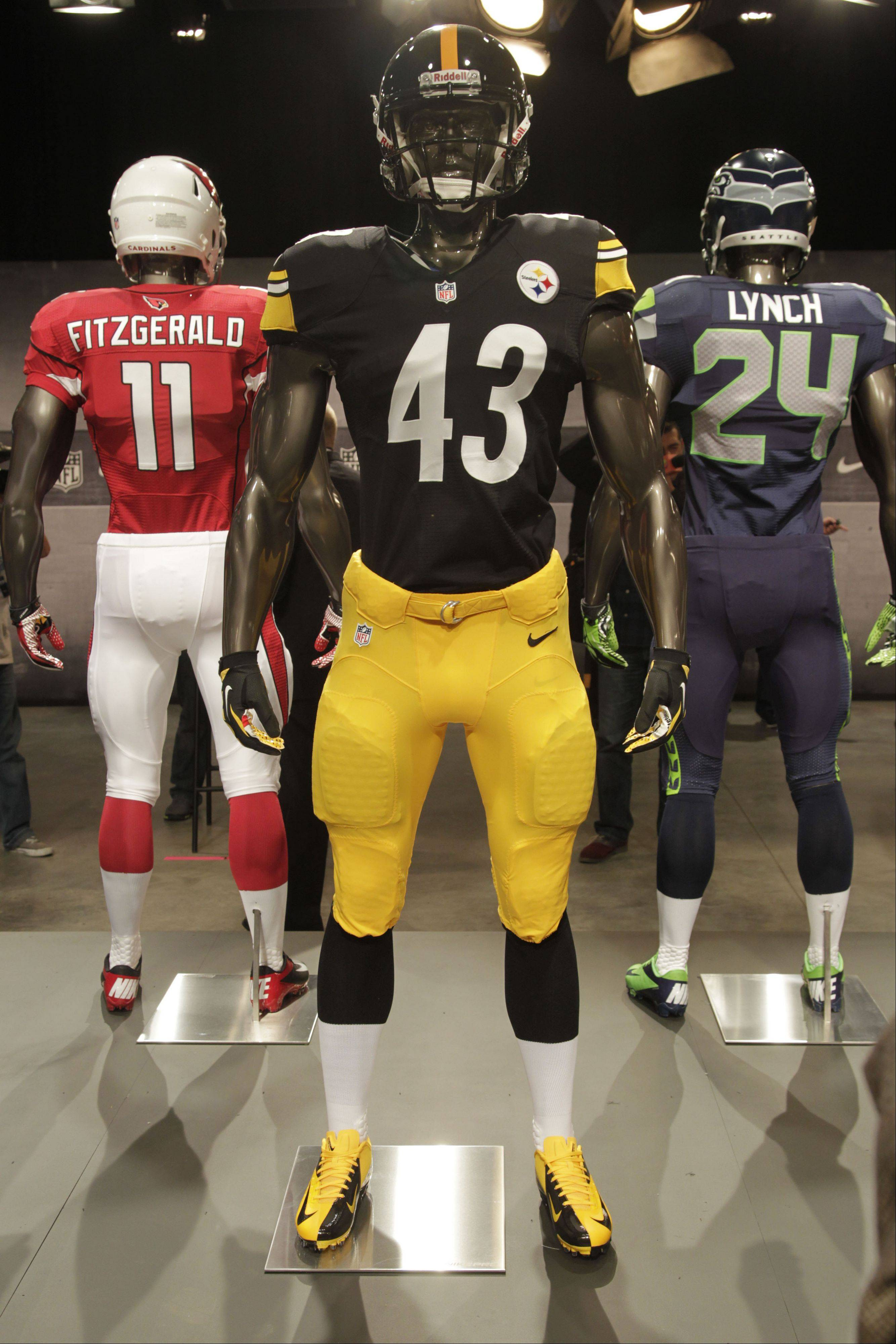 The new Pittsburgh Steelers uniform is displayed on a mannequin in New York, Tuesday, April 3, 2012. NFL has unveiled its new sleek uniforms designed by Nike. While most of the new uniforms are not very different visually, they all are made with new technology that make them lighter, dryer and more comfortable.