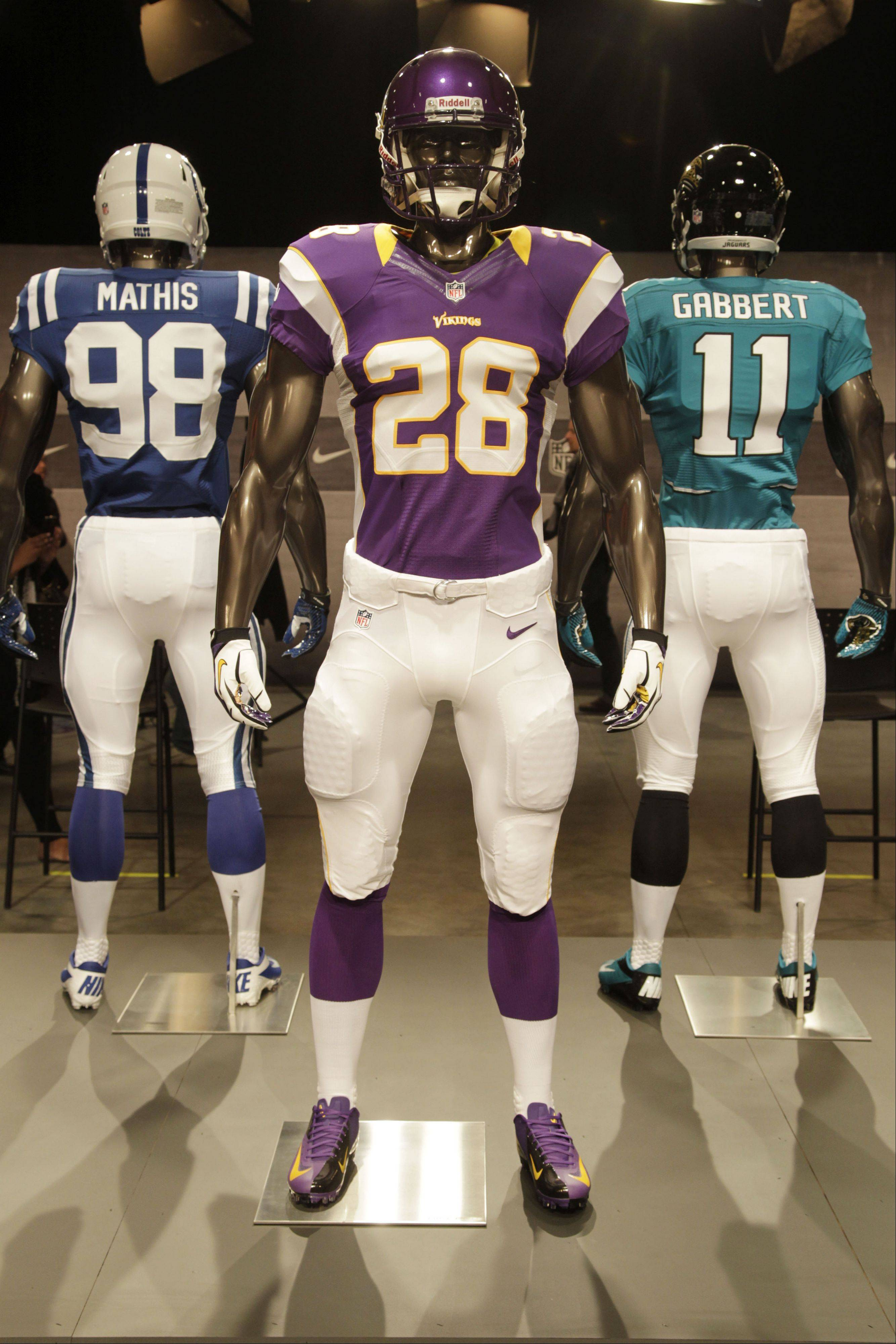 The new Minnesota Vikings uniform is displayed on a mannequin in New York, Tuesday, April 3, 2012. NFL has unveiled its new sleek uniforms designed by Nike. While most of the new uniforms are not very different visually, they all are made with new technology that make them lighter, dryer and more comfortable.