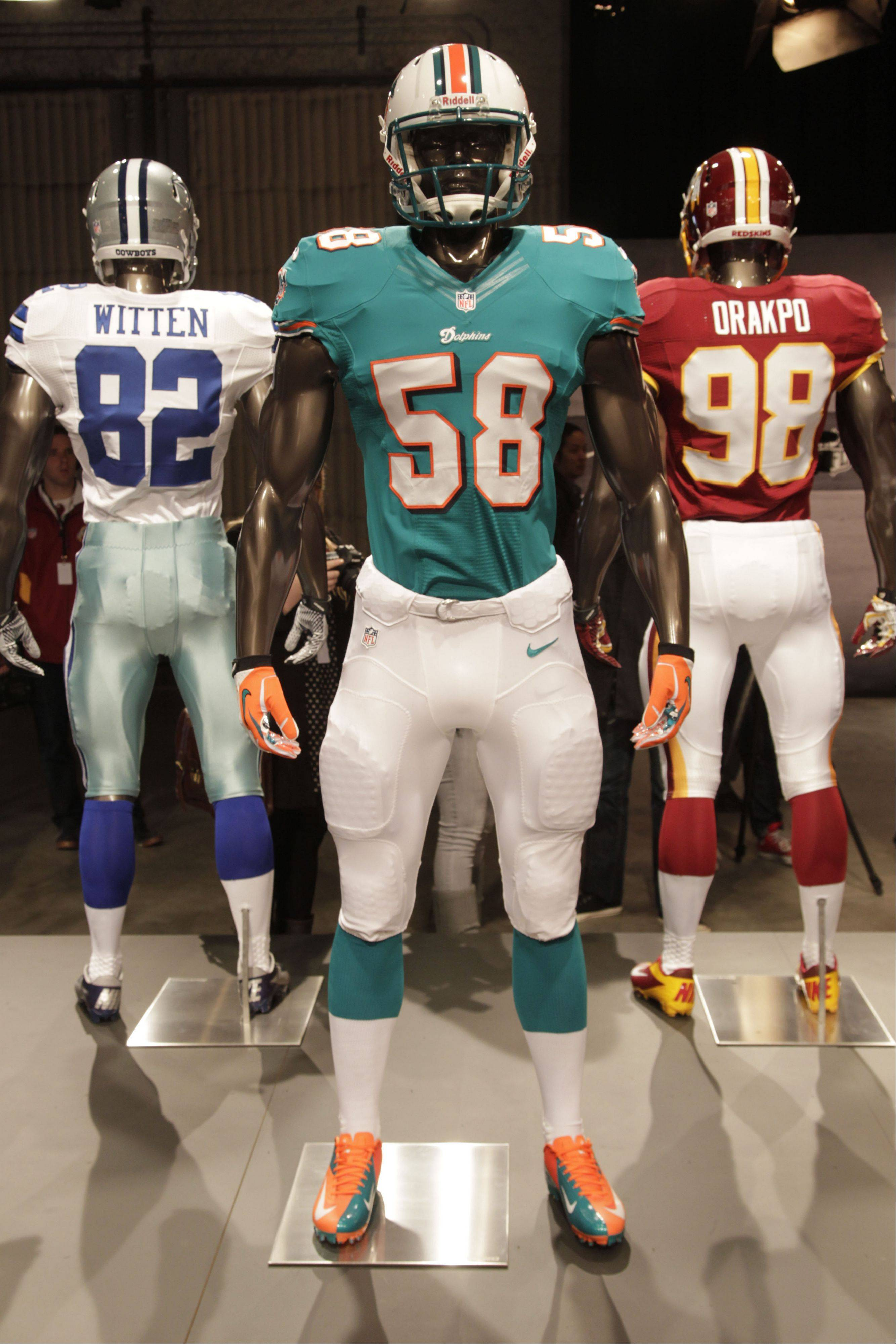 The new Miami Dolphins uniform is displayed on a mannequin in New York, Tuesday, April 3, 2012. NFL has unveiled its new sleek uniforms designed by Nike. While most of the new uniforms are not very different visually, they all are made with new technology that make them lighter, dryer and more comfortable.