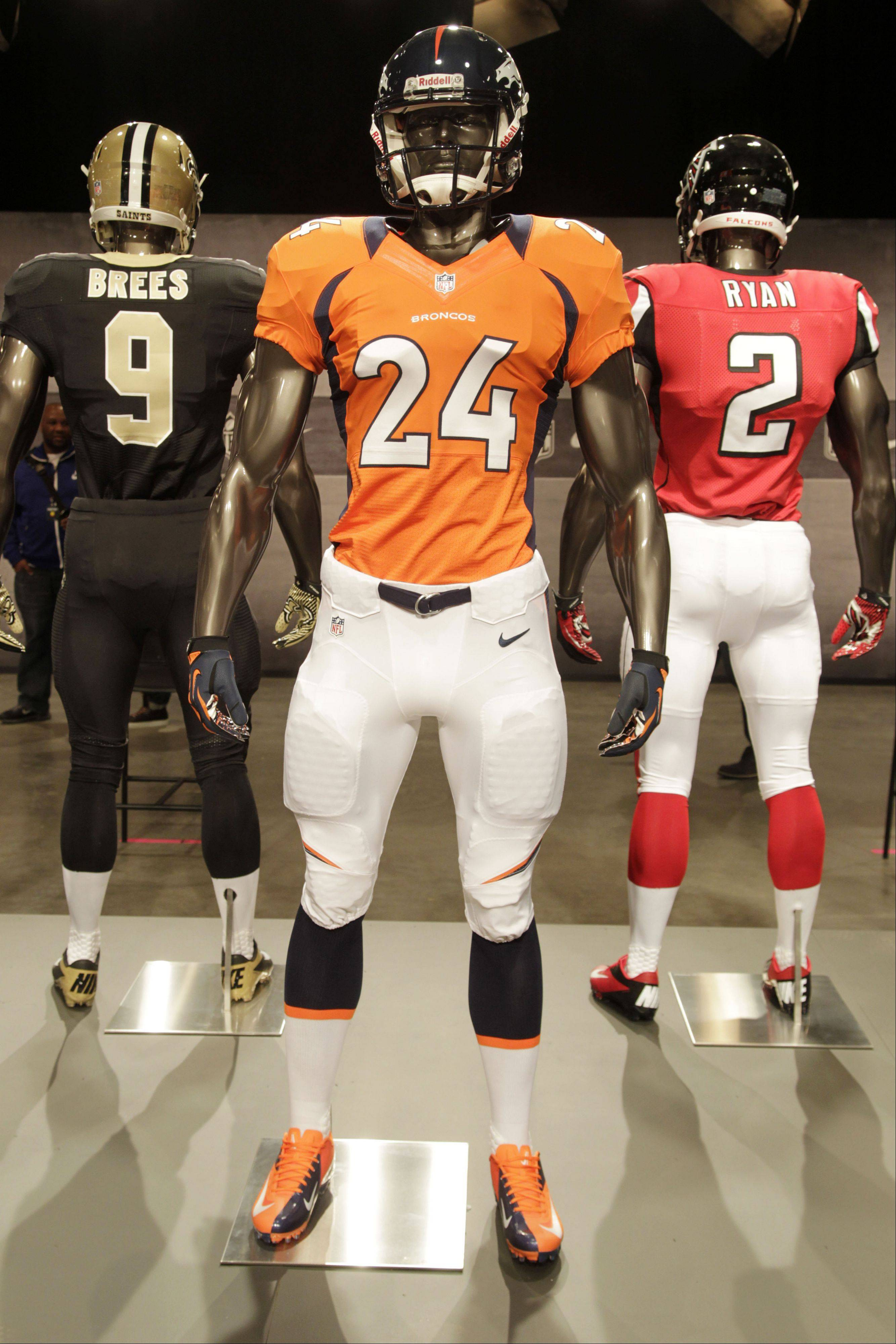 The new Denver Broncos uniform is displayed on a mannequin in New York, Tuesday, April 3, 2012. NFL has unveiled its new sleek uniforms designed by Nike. While most of the new uniforms are not very different visually, they all are made with new technology that make them lighter, dryer and more comfortable.
