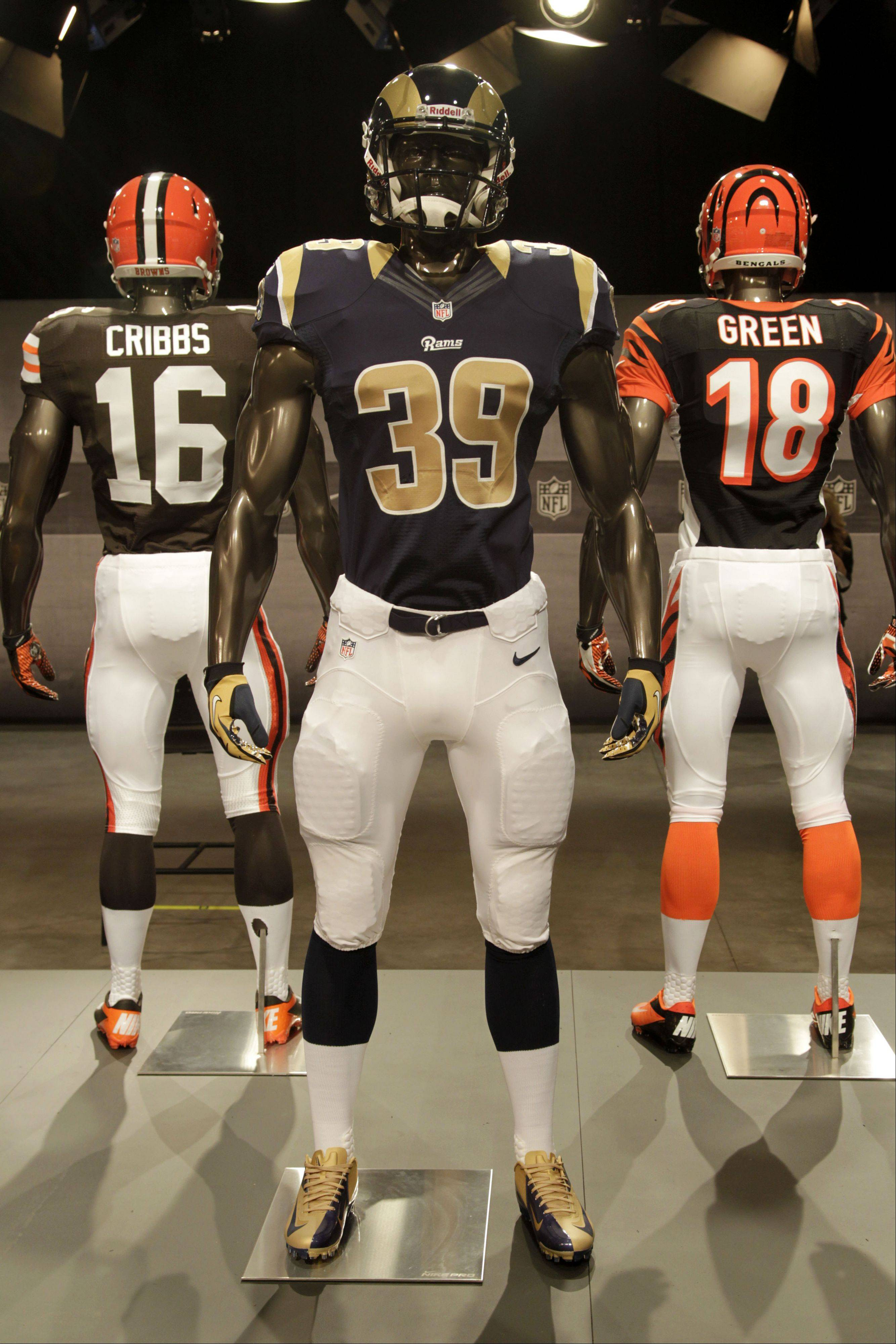 The new St. Louis Rams uniform is displayed on a mannequin in New York, Tuesday, April 3, 2012. NFL has unveiled its new sleek uniforms designed by Nike. While most of the new uniforms are not very different visually, they all are made with new technology that make them lighter, dryer and more comfortable.
