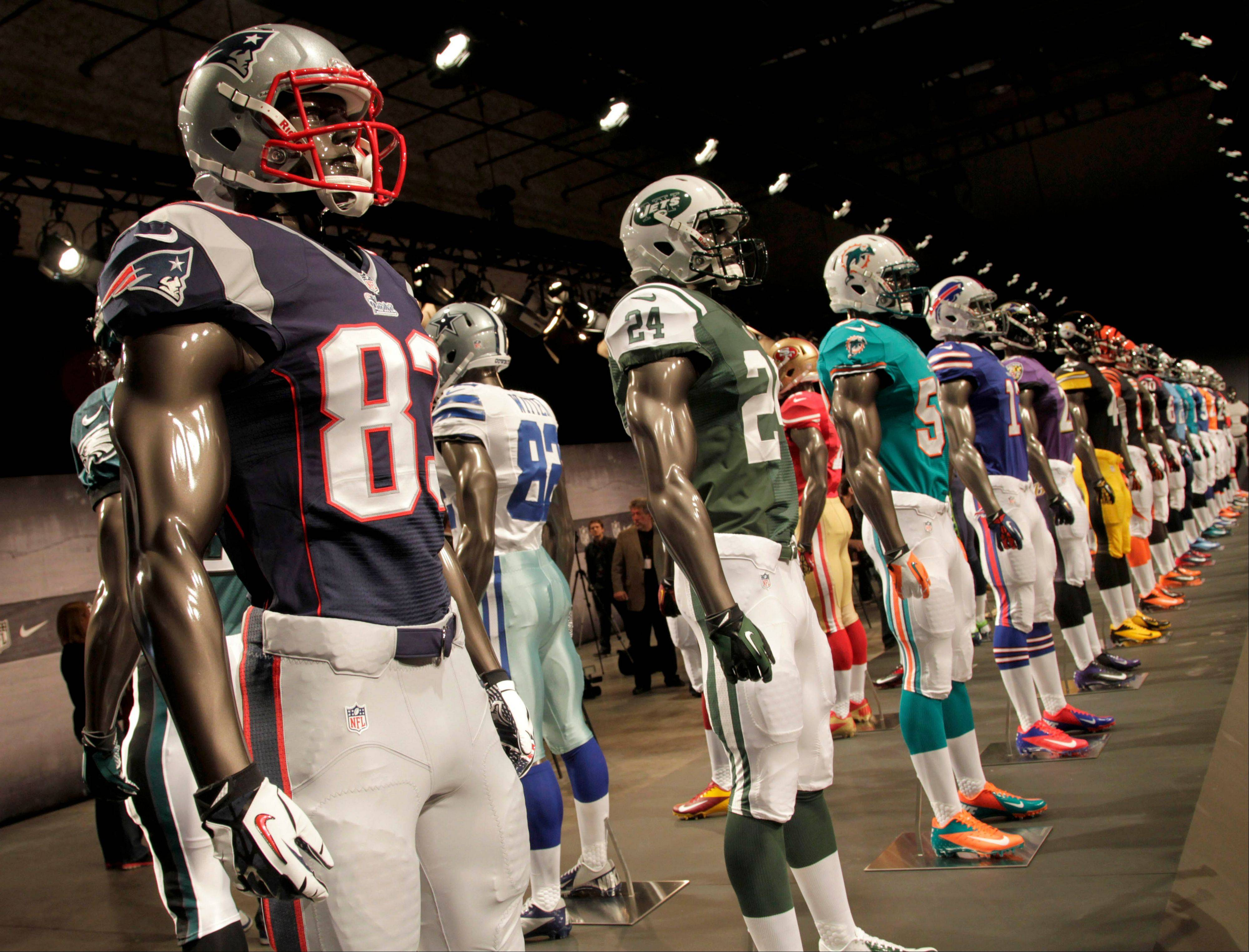 New NFL uniforms are displayed on mannequins during a presentation in New York, Tuesday, April 3, 2012. The NFL and Nike showed off the new look in grand style with a gridiron-styled fashion show at a Brooklyn film studio.