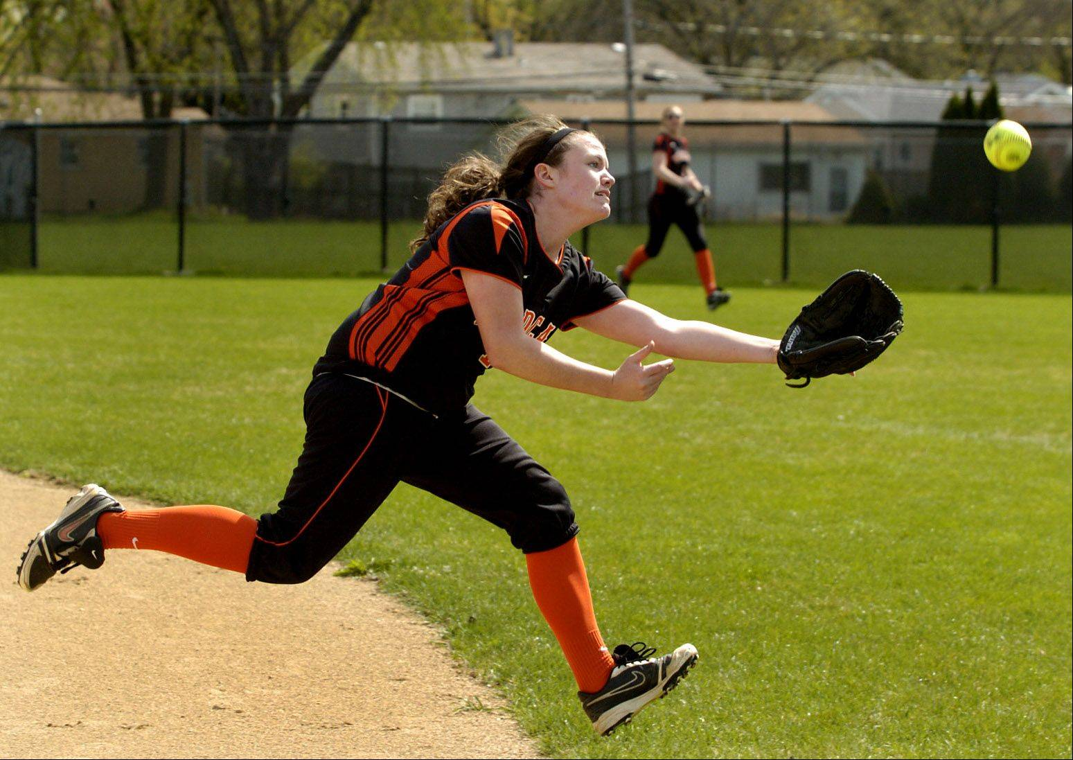 Libertyville first baseman Val Steinhauser just misses the ball during Thursday's softball game against Rolling Meadows.