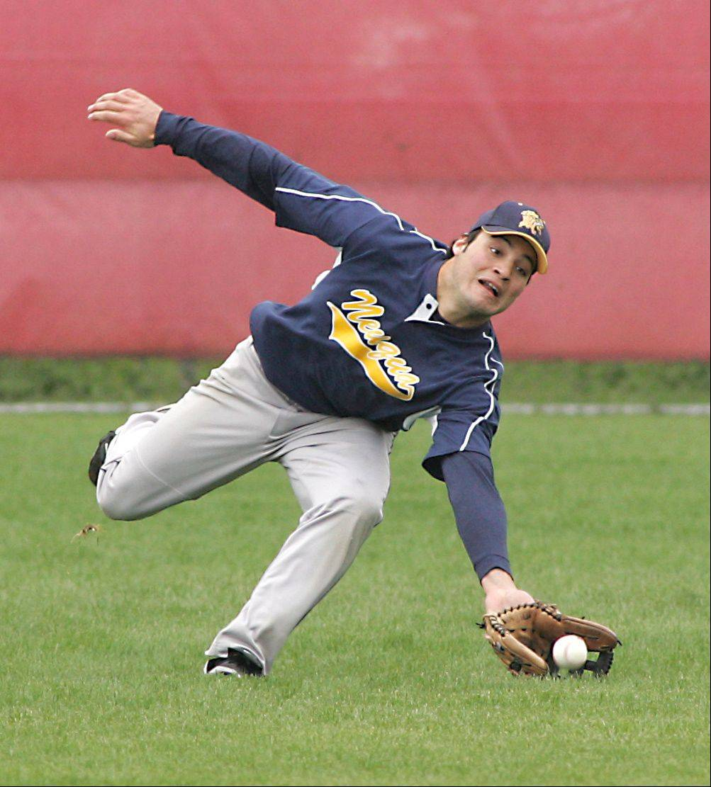 Neuqua Valley's Jack Amaro makes a shoestring catch against Naperville Central during Saturday's baseball game in Naperville.