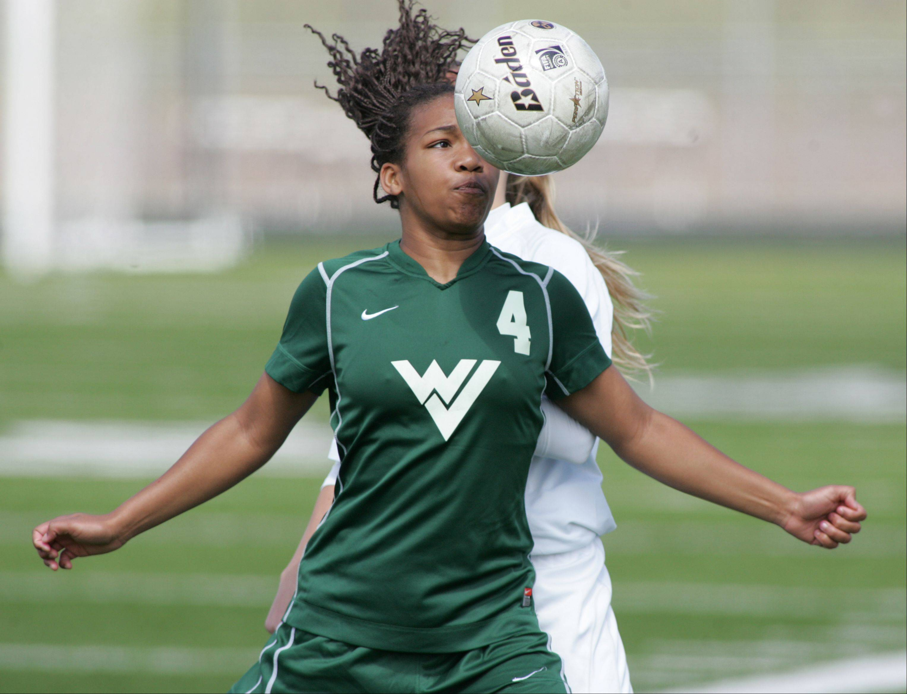 Waubonsie Valley's Kristen Dodson, 4, battles Metea Valley during Saturday's soccer game in Aurora.