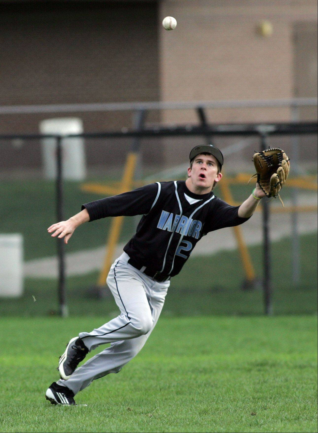 Willowbrook's Steven Ferguson makes a catch in right field in action against Glenbard East Monday in Lombard.