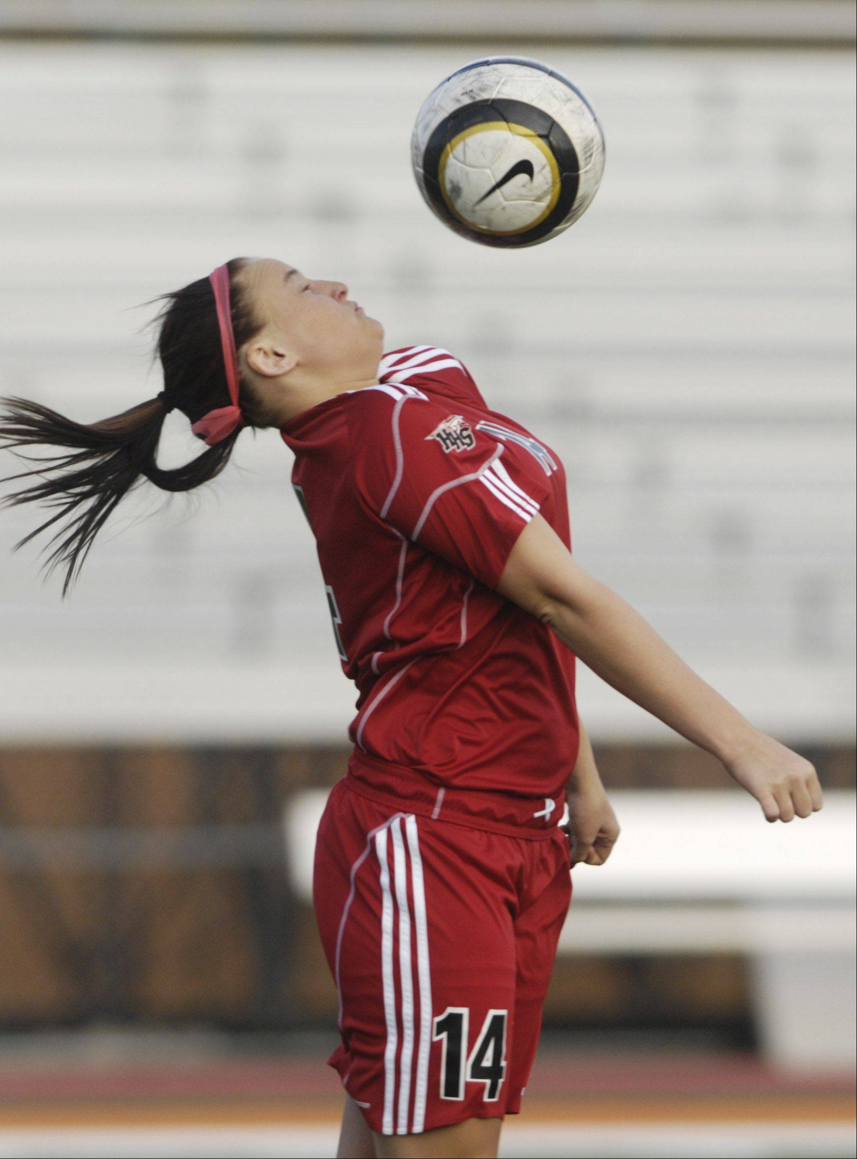 Huntley's Summer Campbell leaps to control the ball during Tuesday's game in Arlington Heights.