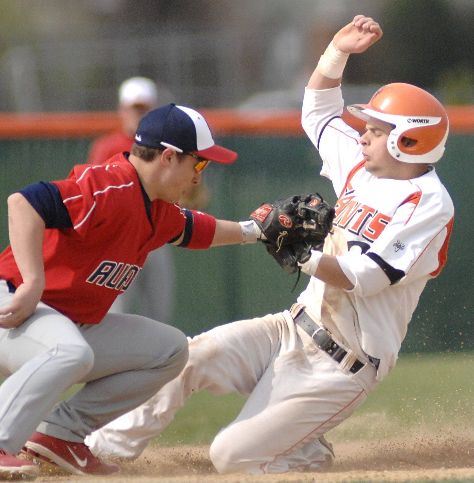 St. Charles East's Nicholas Erickson is safe at second as West Aurora's Adam Lipscomb attempts the tag during Tuesday's baseball game.